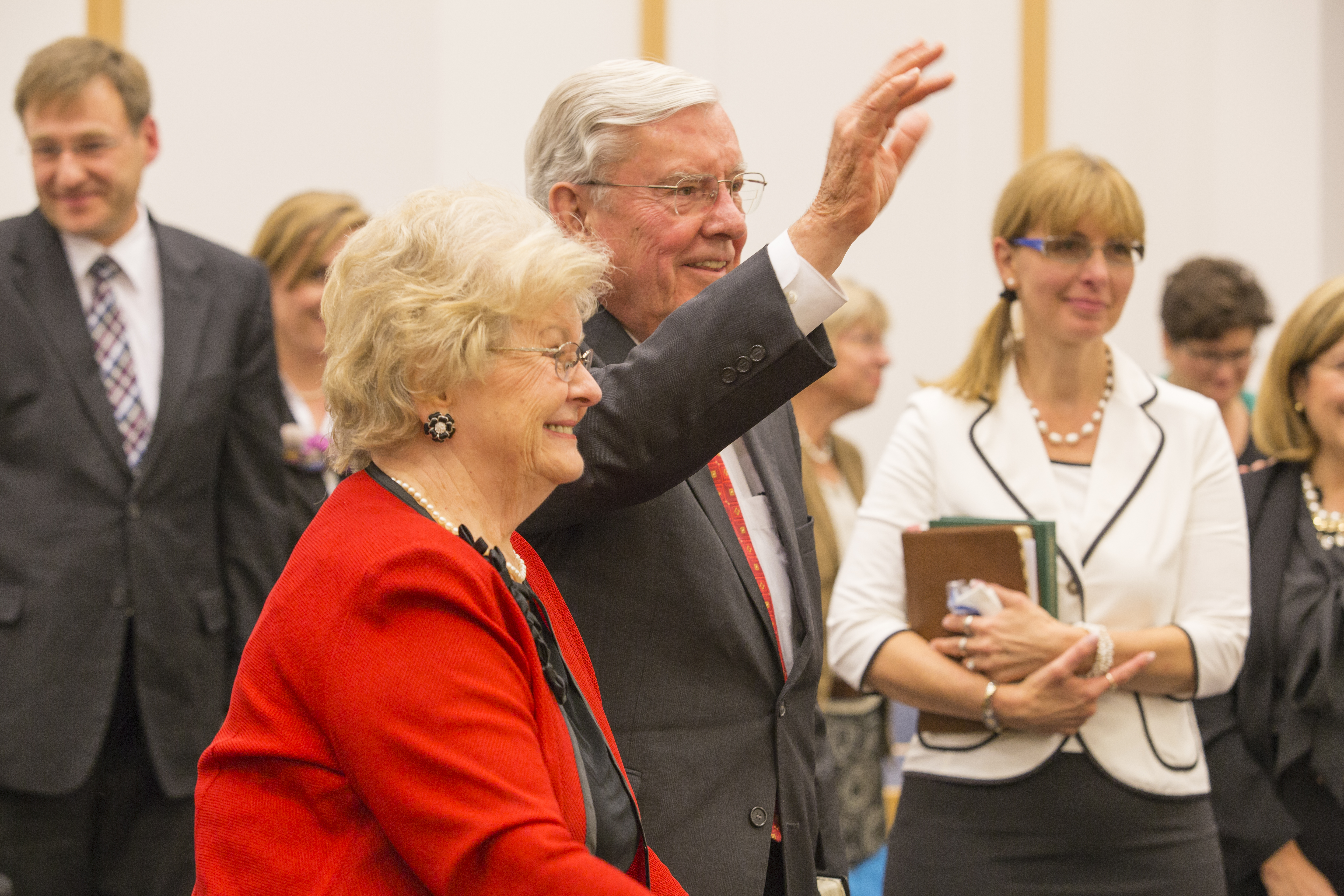 Elder M. Russell Ballard and Sister Barbara B. Ballard wave to congregation at the conclusion of the Europe Area Sisters Meeting in September 2014. The meeting originated in Frankfurt, Germany, and was broadcast throughout Europe.