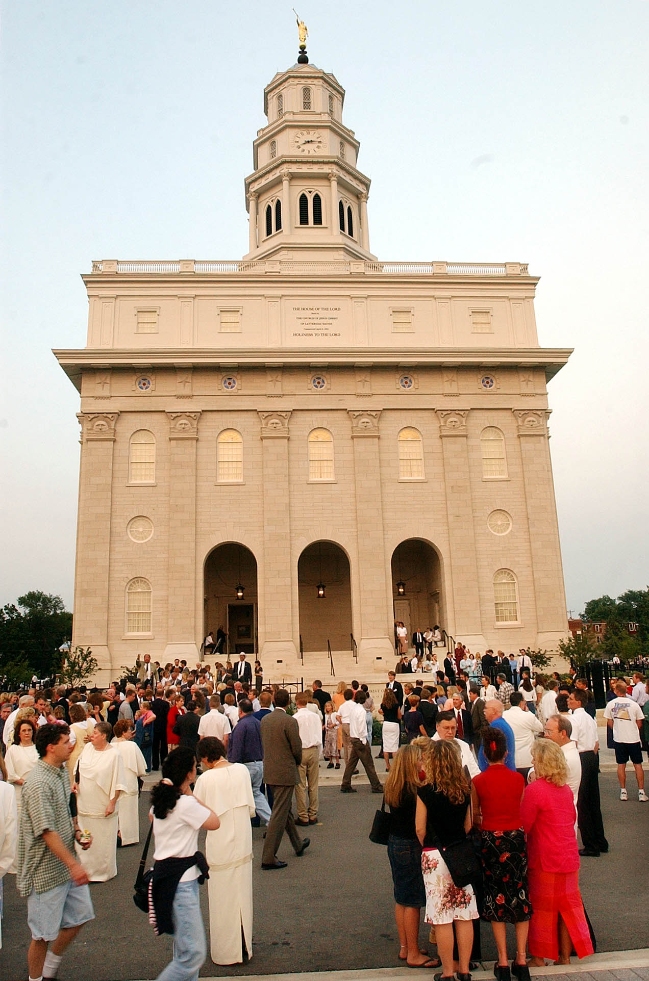 Crowds stand outside the Nauvoo Illinois Temple after its first dedication session June 27, 2002.