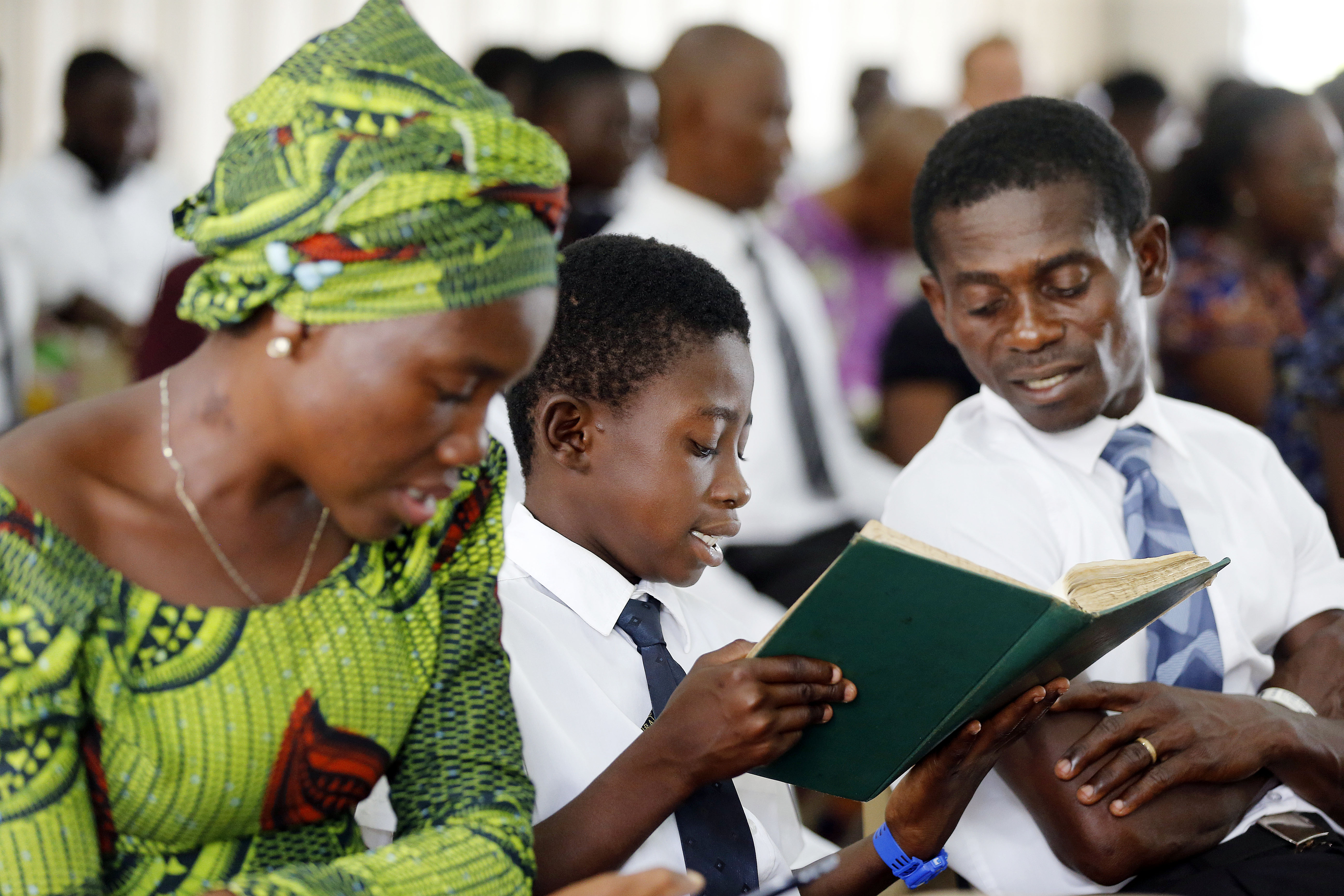Rebecca Mawusi, Joseph Smith Addai, and his father Andrews Adu Gyamfi sing during Sacrament Meeting at the Bantama Stake Center in Kumasi, Ghana on Sunday, April 22, 2018. In November 2018, the Young Women general presidency wrote about how the sacred emblems of the sacrament help us remember Jesus Christ.
