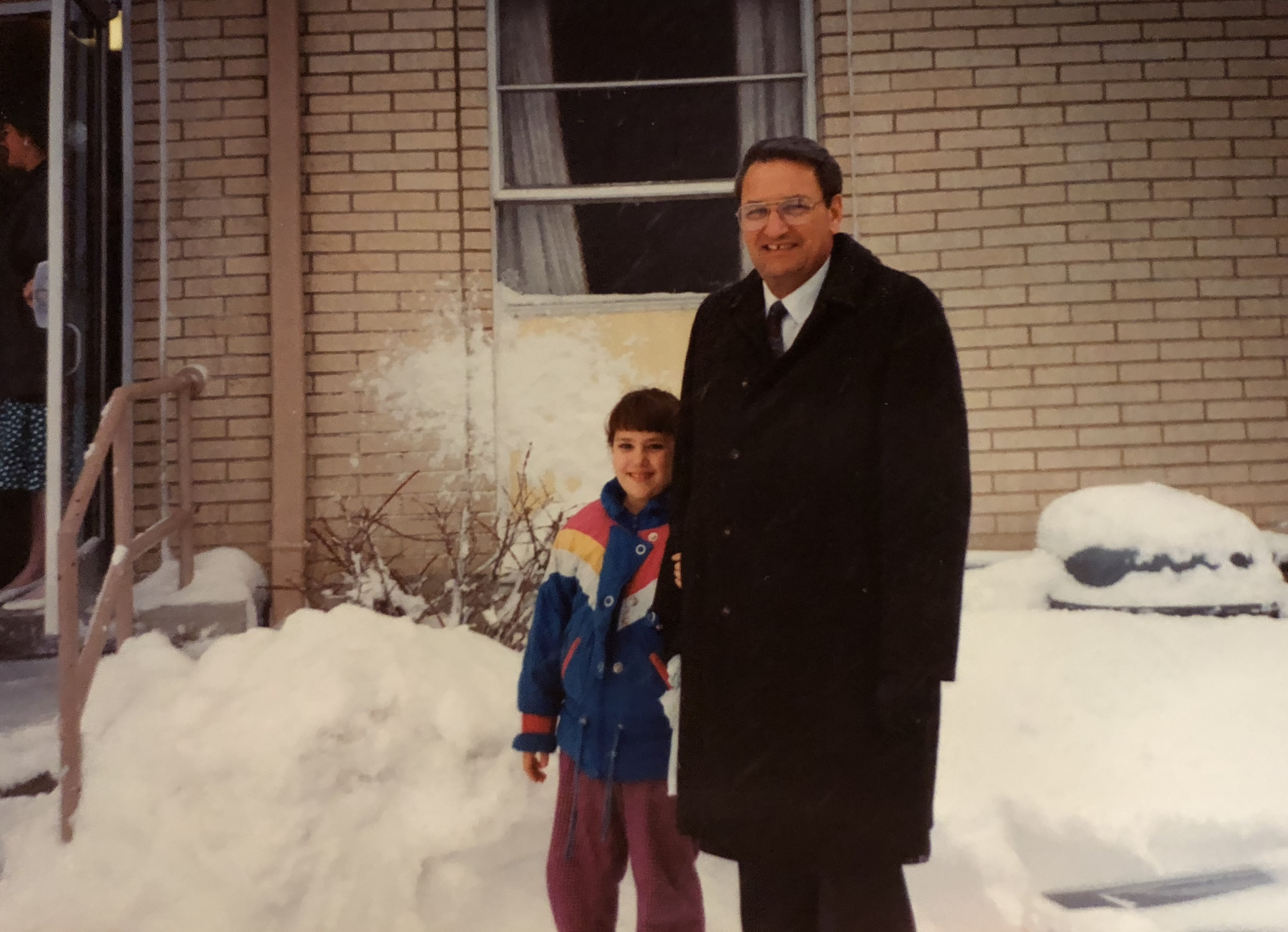 Rachel Sterzer with her father in front of the stake center on the day of her baptism in January 1993.