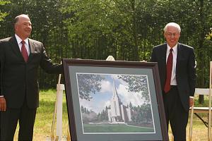 Elder Ronald A. Rasband, left, with Elder William R. Walker, shows artist's rendering of new temple.