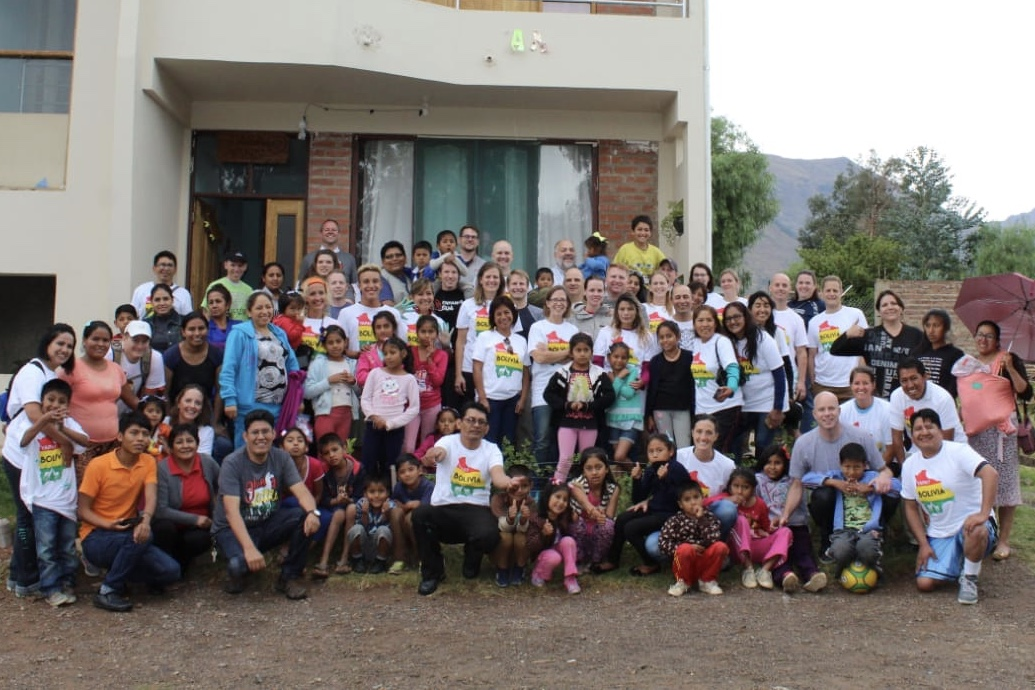 The mission reunion group at the Ciudad de la Bonded orphanage in October. A nonprofit organization, which was started by four women from the mission group, does humanitarian work throughout Bolivia and they mission reunion group partnered with them to help expand the orphanage.