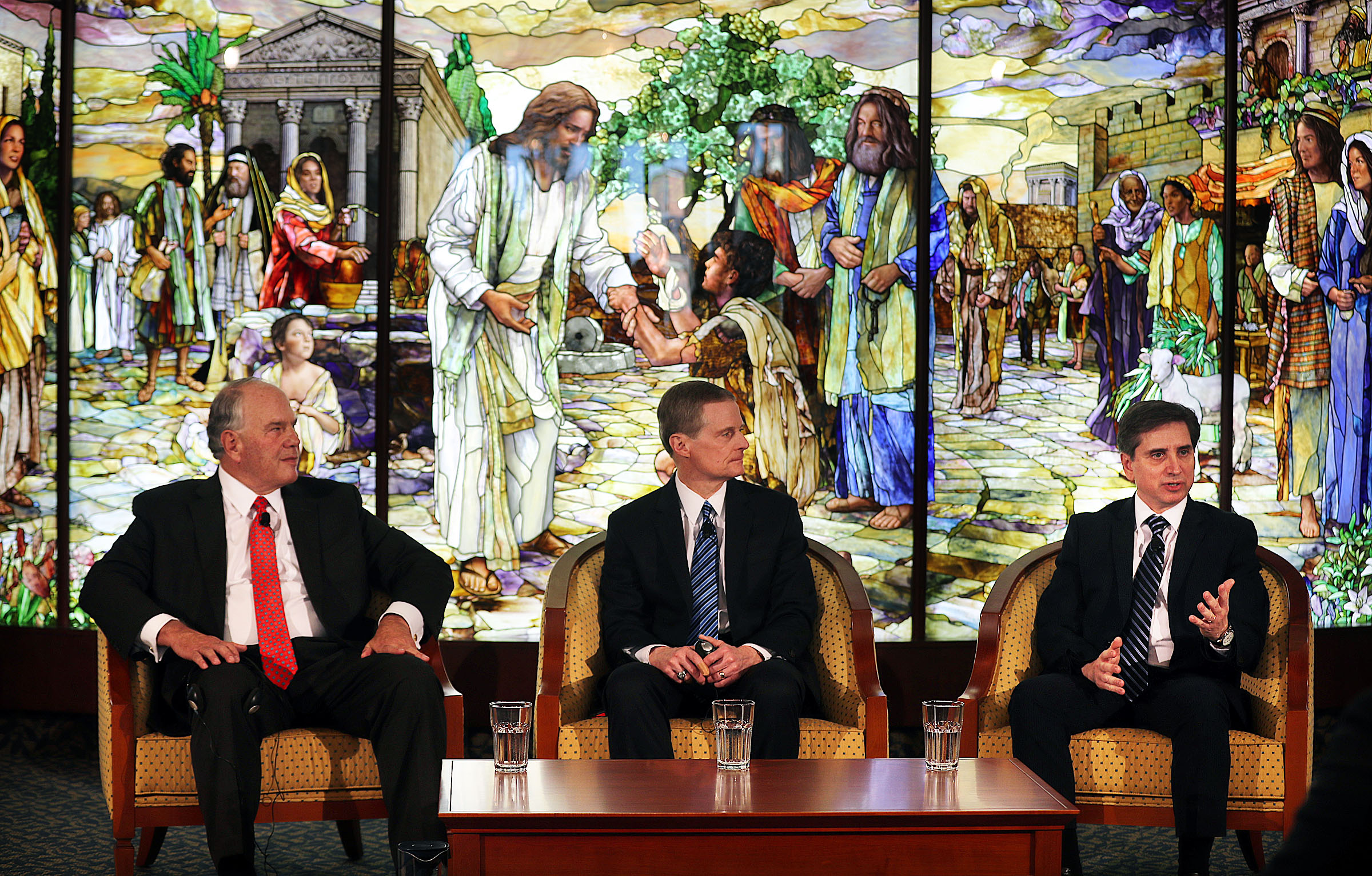 Elder Massimo De Feo, General Authority Seventy, right, speaks during a press conference in the Rome Temple Visitors' Center of The Church of Jesus Christ of Latter-day Saints on Monday, Jan. 14, 2019. At left are Elder Ronald A. Rasband, left, and Elder David A. Bednar of the Quorum of the Twelve Apostles.