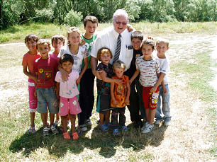 Elder Sam Juncker meets with children after toys and clothing were distributed in Turiqca, Kosovo. The students and their families responded with gratitude and love.