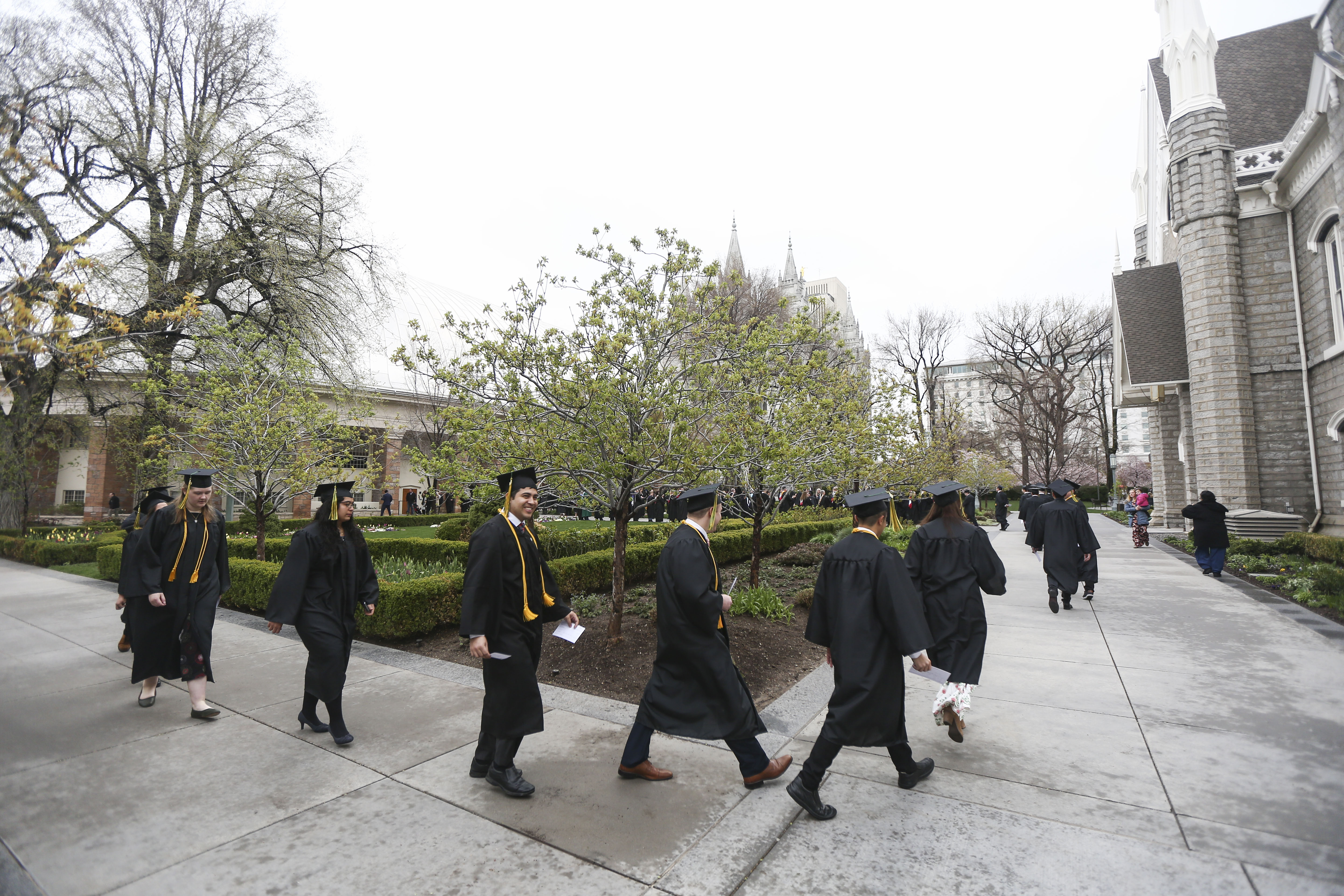 Students from the LDS business college walk to the Tabernacle at Temple Square for their commencement ceremony in Salt Lake City on Friday, April 12, 2019.