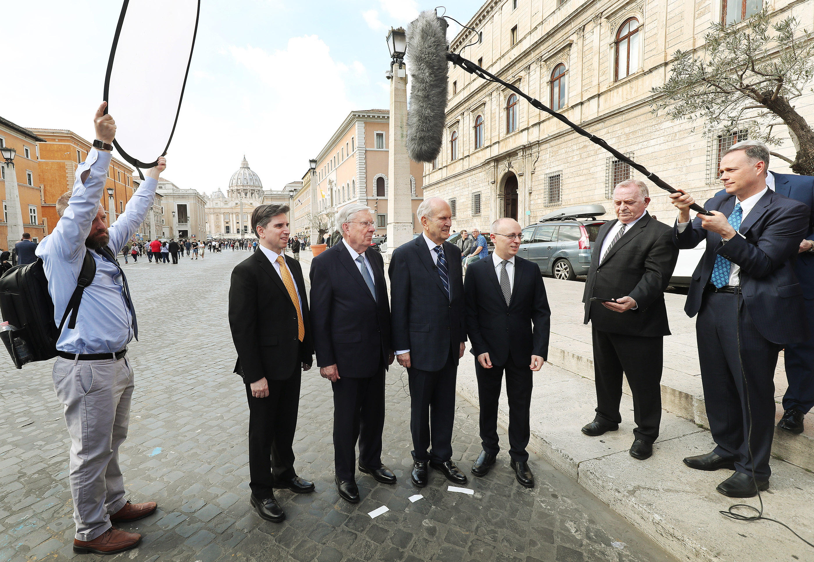 President Russell M. Nelson of The Church of Jesus Christ of Latter-day Saints; President M. Russell Ballard, acting president of the Quorum of the Twelve Apostles; Elder Massimo De Feo, General Authority Seventy, left; and Elder Alessandro Dini Ciacci, Area Seventy, right, are interviewed by media near the Vatican in Rome, Italy, on Saturday, March 9, 2019, after meeting with Pope Francis.