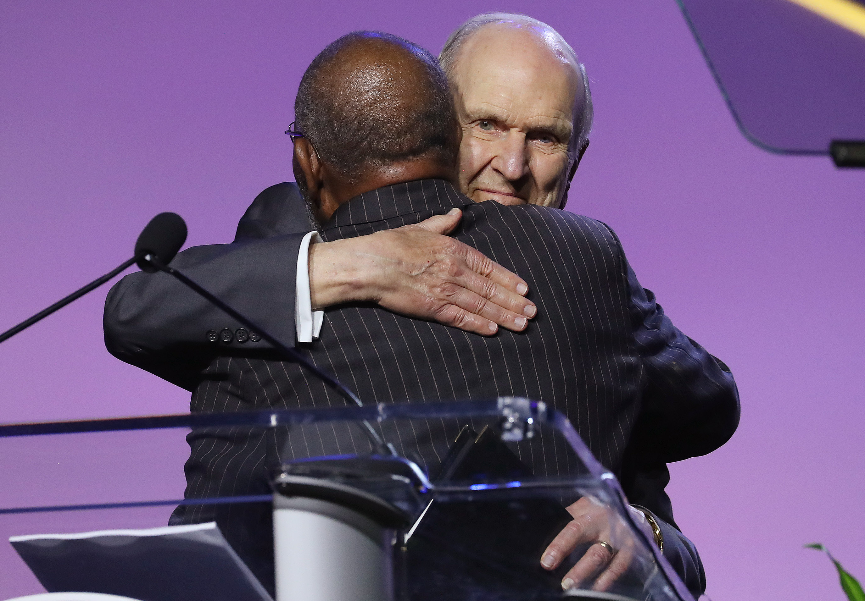 President Russell M. Nelson of The Church of Jesus Christ of Latter-day Saints hugs the Reverend Amos C. Brown after his introduction at the 110th annual national convention for the National Association for the Advancement of Colored People in Detroit on Sunday, July 21, 2019.