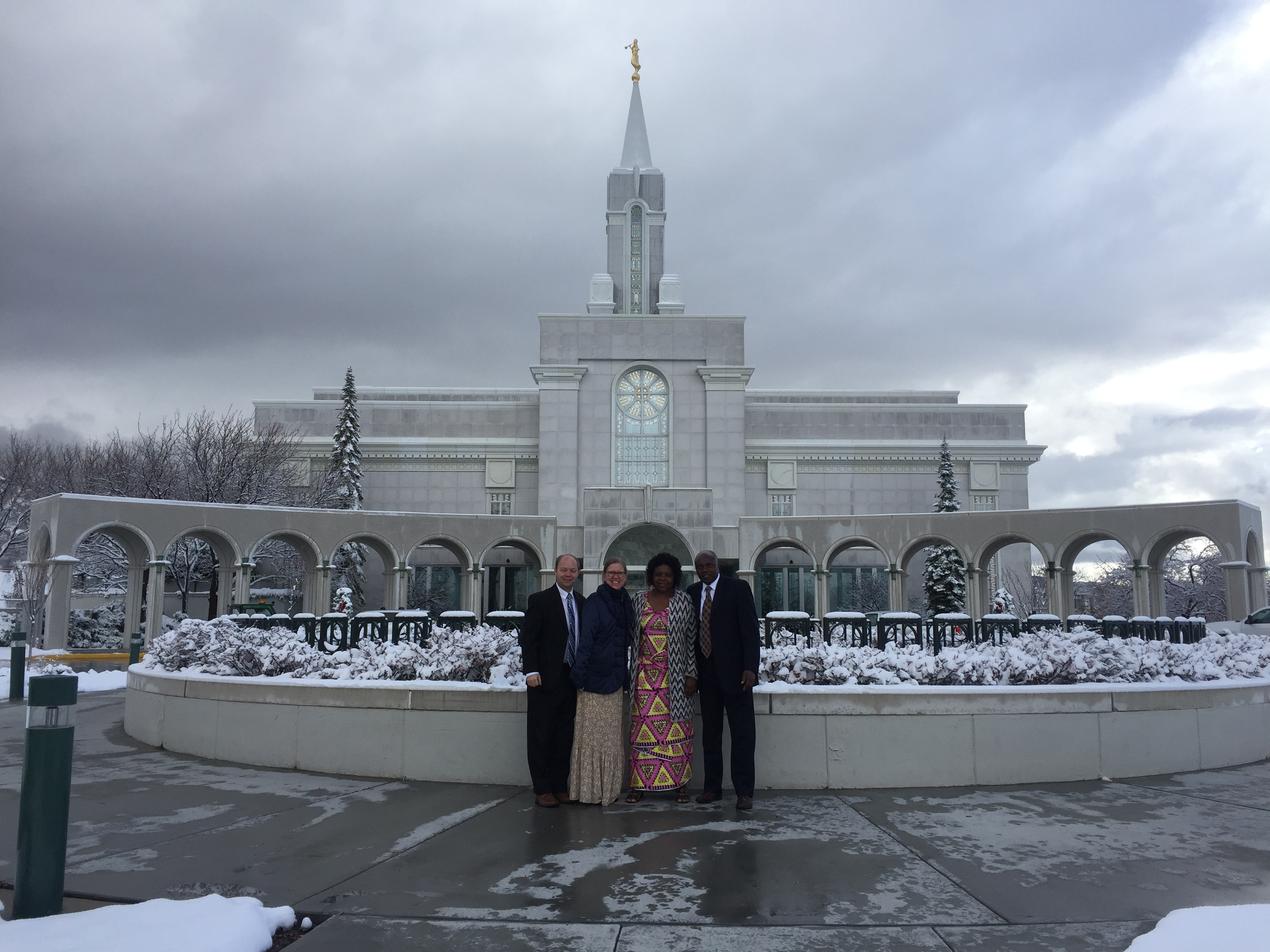 From left, Charles Graham, Dawn Graham, stand with Donatira Kabaji and Mitonzi Bakunz in front of the Bountiful Utah Temple after accompanying them through the temple for their first time.