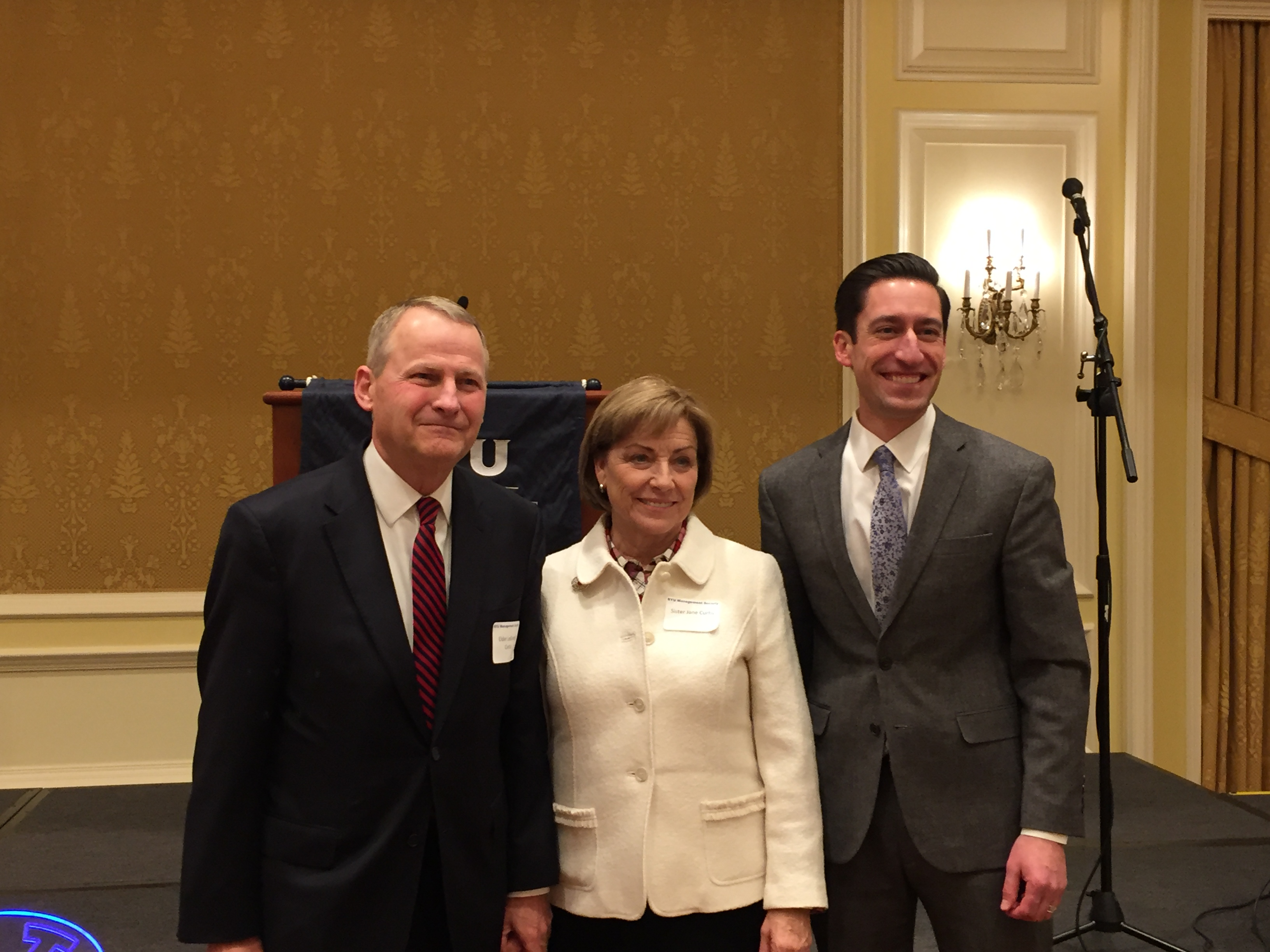 Left to right: Elder LeGrand R. Curtis, Sister Jane Curtis, and Matthew Sadowski, chapter president, after the BYU Management Society Devotional at the Little America Hotel on Dec. 11 in Salt Lake.
