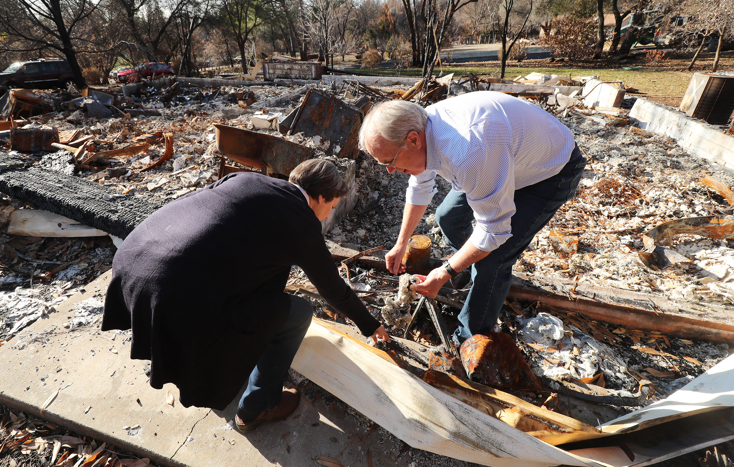 Rick and Kathie Turner find items as they look over their destroyed home in Paradise, California, on Saturday, Jan. 12, 2019, two months after the Camp Fire destroyed more than 18,000 homes and businesses.