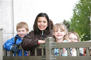 From left, Joseph Mellor, 5, Grace DeFeo, 9, Natalia Bates, 6, view the temple.