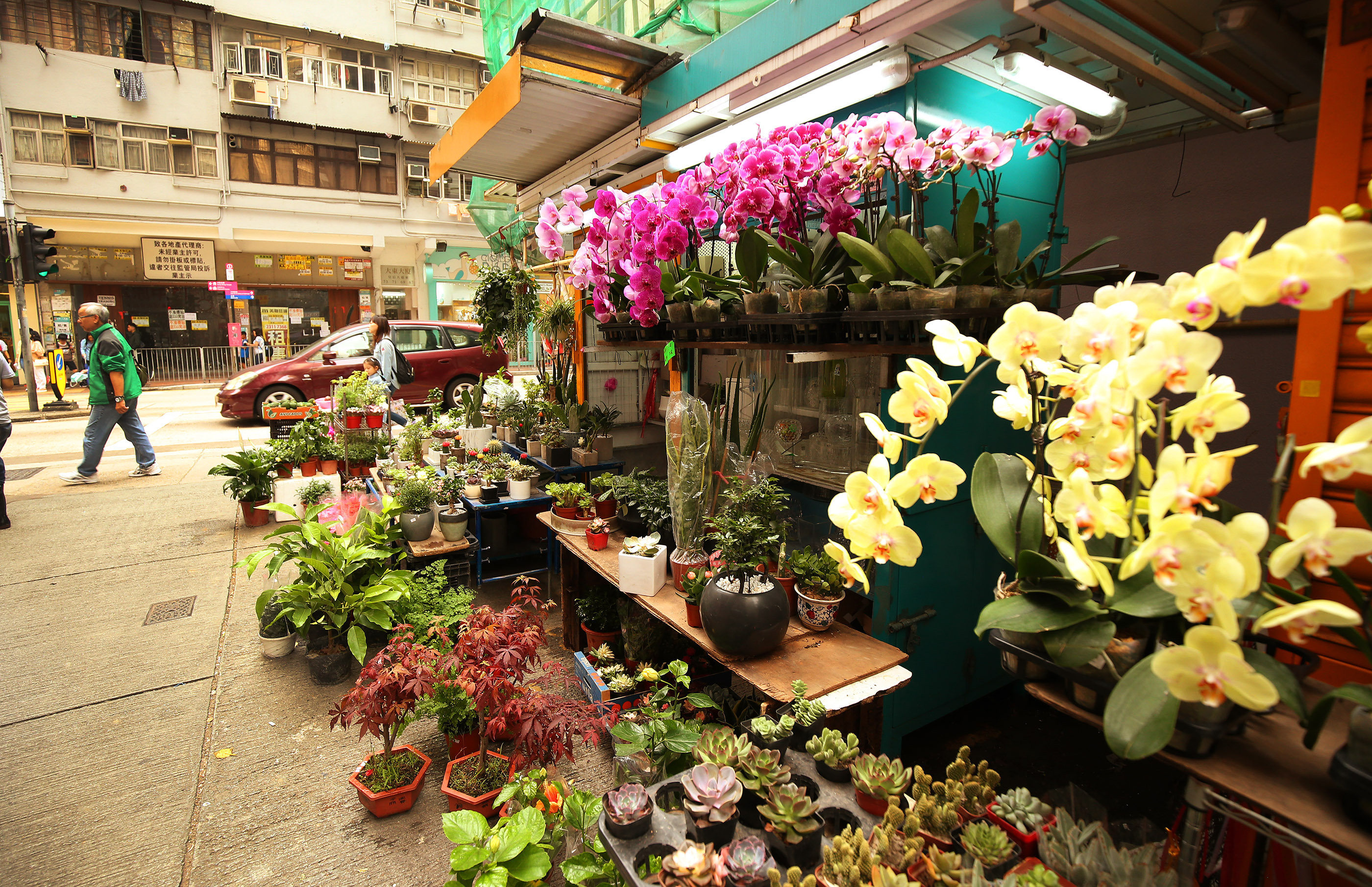 Flowers are sold in the market in Hong Kong on Saturday, April 21, 2018.