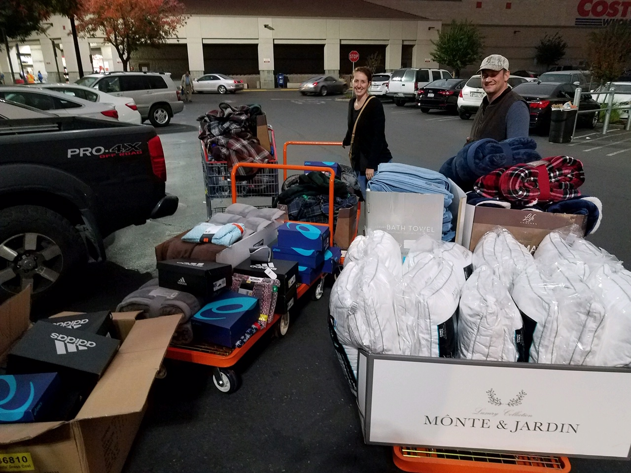 Sean Chambers and fiancé Rachel Hetts buying supplies at Costco with donations to bring to the evacuees of the Camp Fire wildfire in Paradise, Calif.