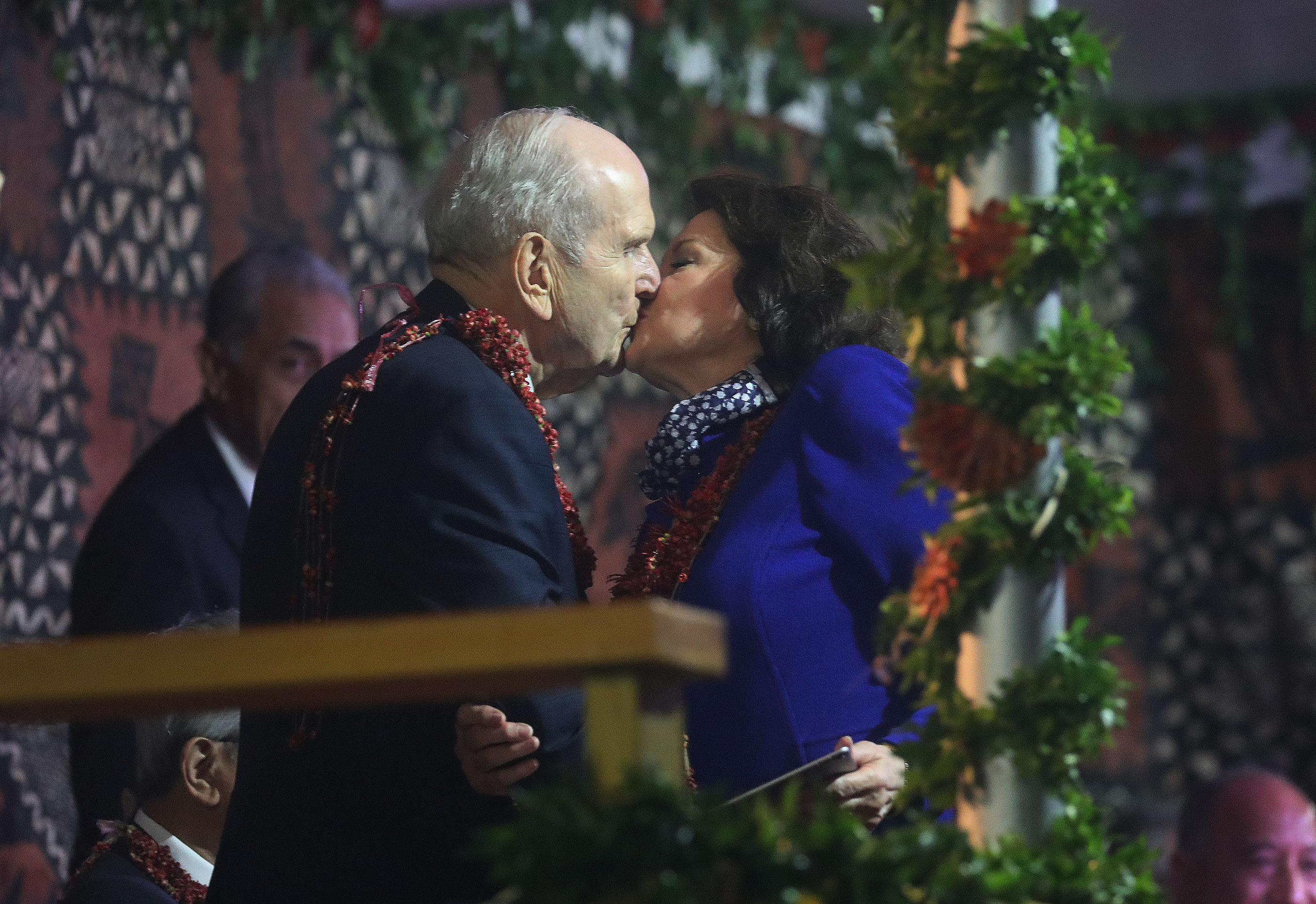 President Russell M. Nelson of The Church of Jesus Christ of Latter-day Saints kisses his wife, Sister Wendy Nelson, prior to speaking during a devotional in Nuku'alofa, Tonga, on May 23, 2019.