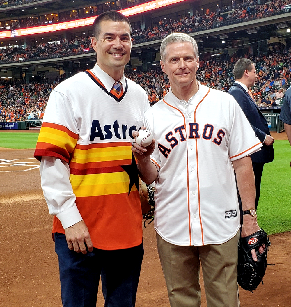 President Jeremy Guthrie and Elder David A. Bednar of the Quorum of the Twelve Apostles prepare to deliver the first pitch of the game between the Houston Astros and the Oakland A's.