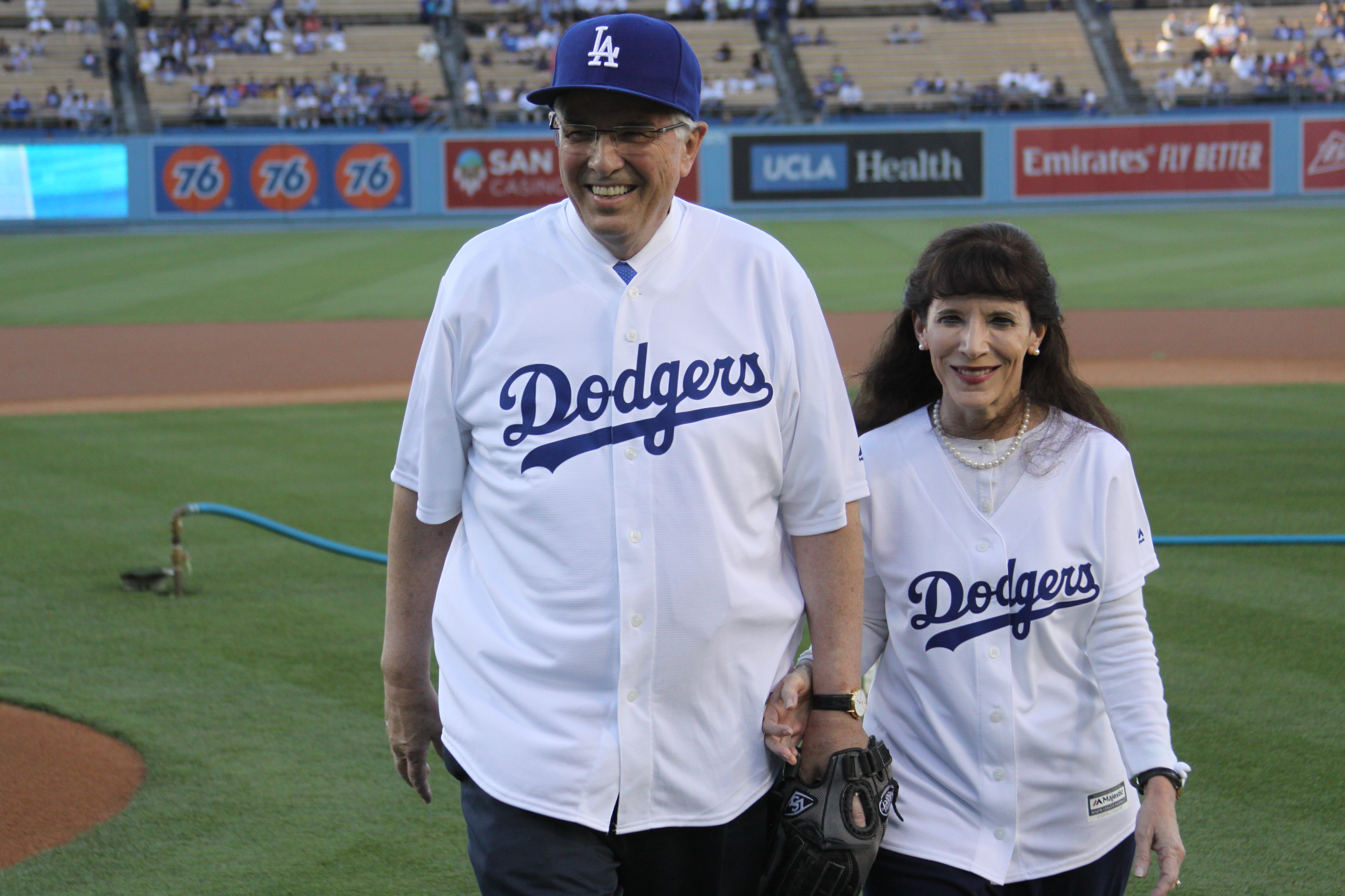 Elder Neil L. Andersen and his wife, Sister Kathy Andersen, on the field during The Church of Jesus Christ of Latter-day Saints Family Night at Dodger Stadium on July 19.