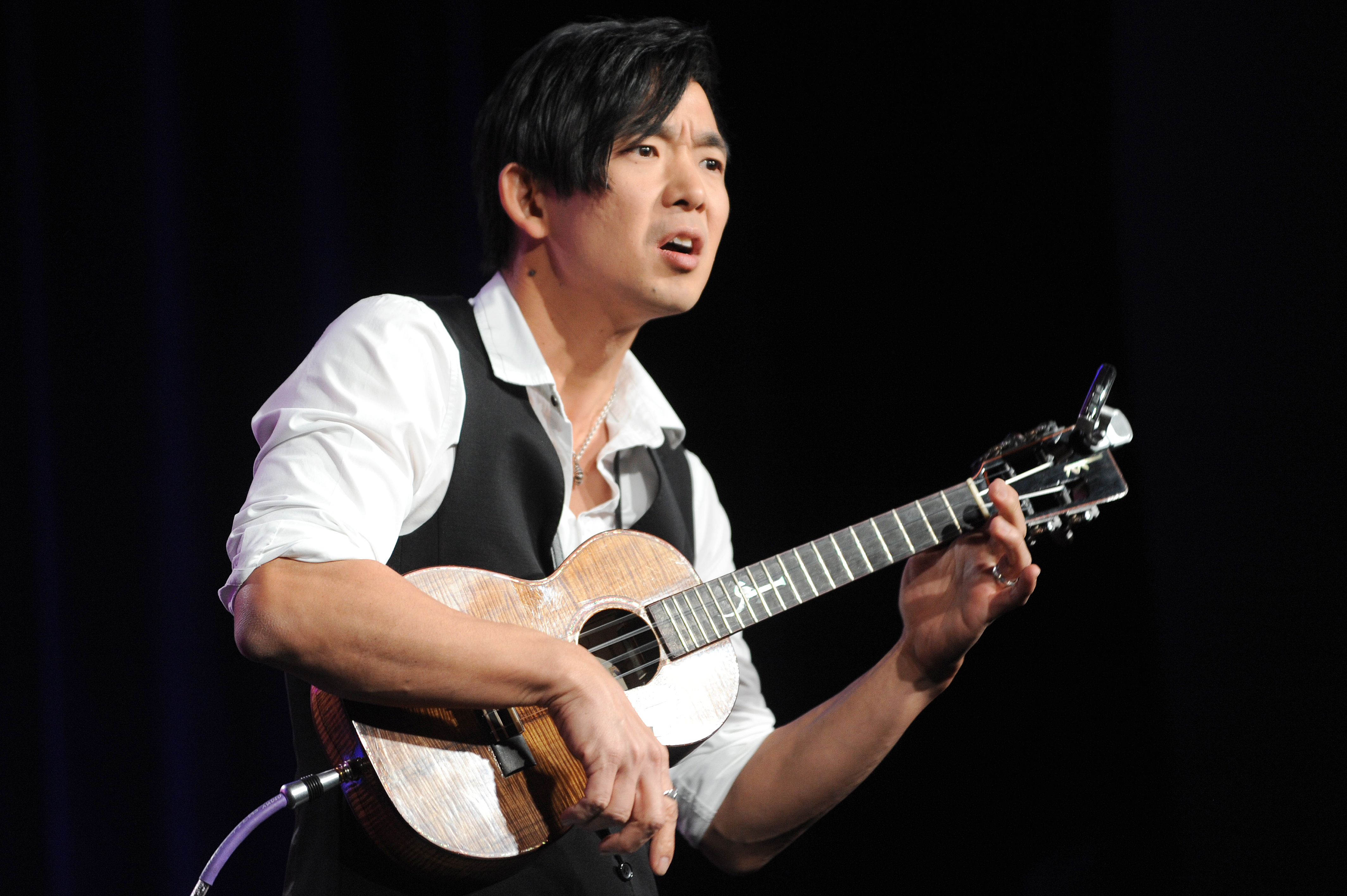 Jake Shimabukuro performs during the PBS Winter TCA Tour at the Langham Huntington Hotel on Tuesday, Jan. 15, 2013, in Pasadena, Calif. Shimabukuro will appear at this year's RootsTech, scheduled for Feb. 27-March 2 at the Salt Palace Convention Center.