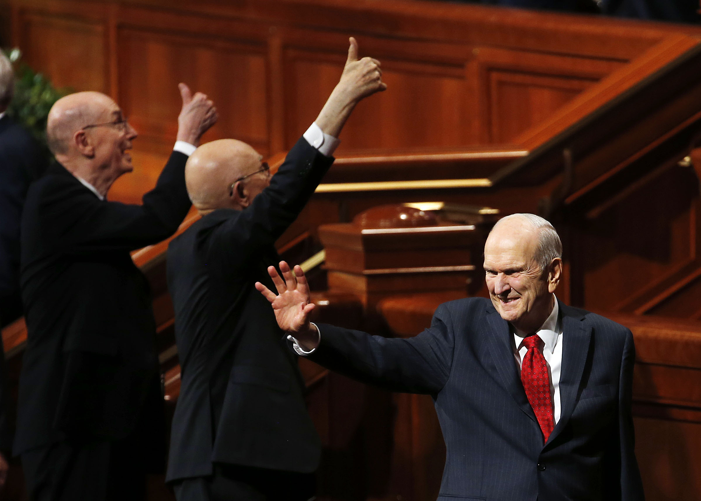 President Russell M. Nelson of The Church of Jesus Christ of Latter-day Saints, right, waves as he and his counselors, President Dallin H. Oaks, first counselor in the First Presidency, and President Henry B. Eyring, second counselor in the First Presidency, leave the Conference Center following the priesthood session of the 189th Annual General Conference in Salt Lake City on Saturday, April 6, 2019.