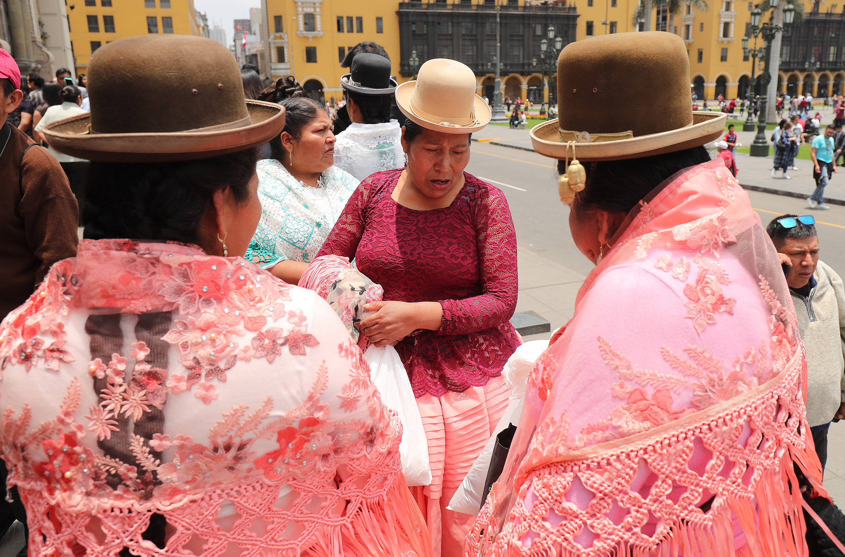 Peruvian women wear traditional dress for a Catholic wedding in Lima, Peru, on Oct. 21, 2018.