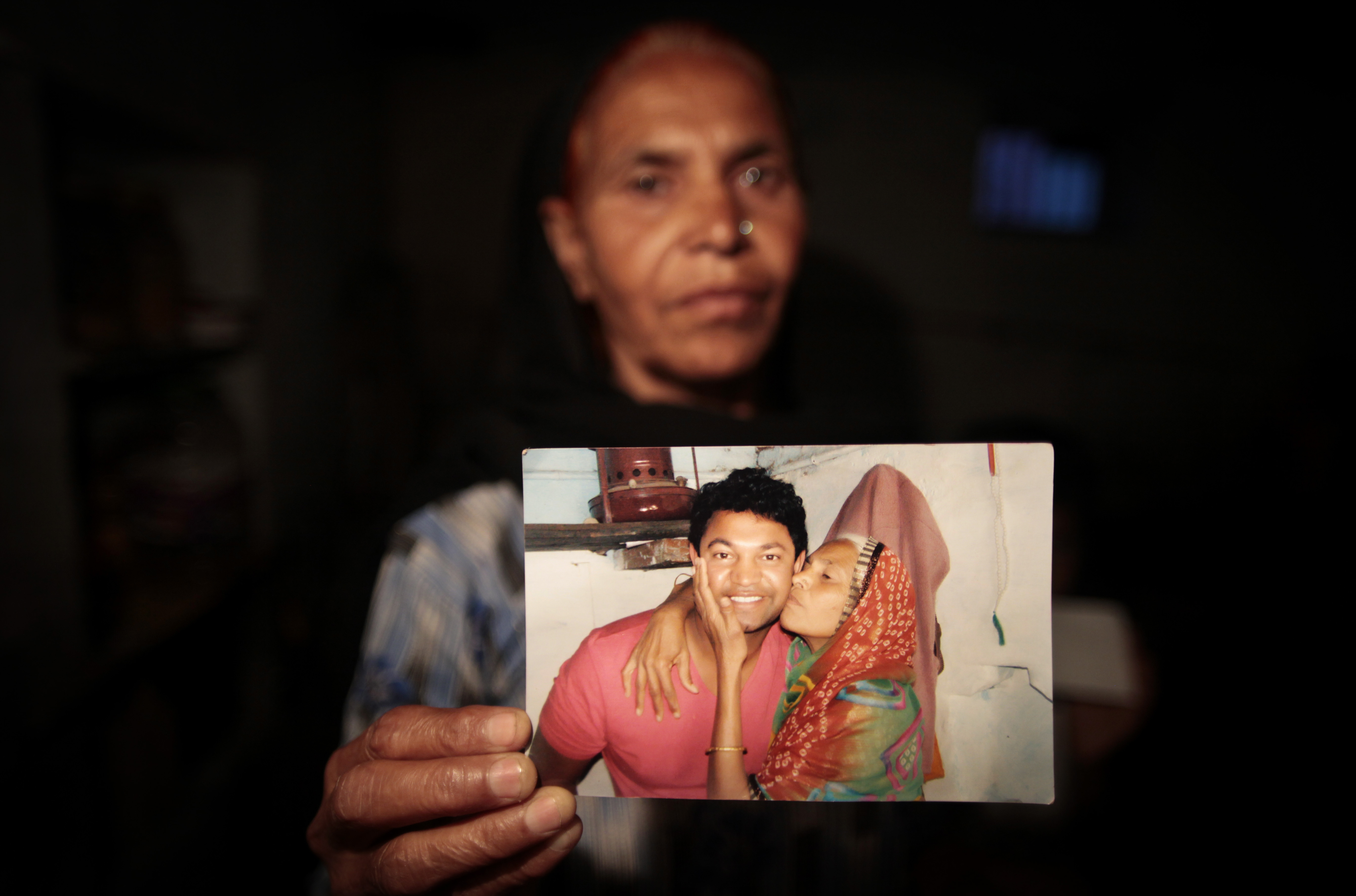 In this May 10, 2012 photo, Fatima Munshi, mother of Saroo, holds up a photo from their reunion in February 2012 at her home in Khandwa, India. Living in Australia, Saroo Brierley, 30, was reunited with his biological mother, Munshi, 25 years after an ill-fated train ride left him an orphan on the streets of Calcutta. Brierley will appear at this year's RootsTech, scheduled for Feb. 27-March 2 at the Salt Palace Convention Center.
