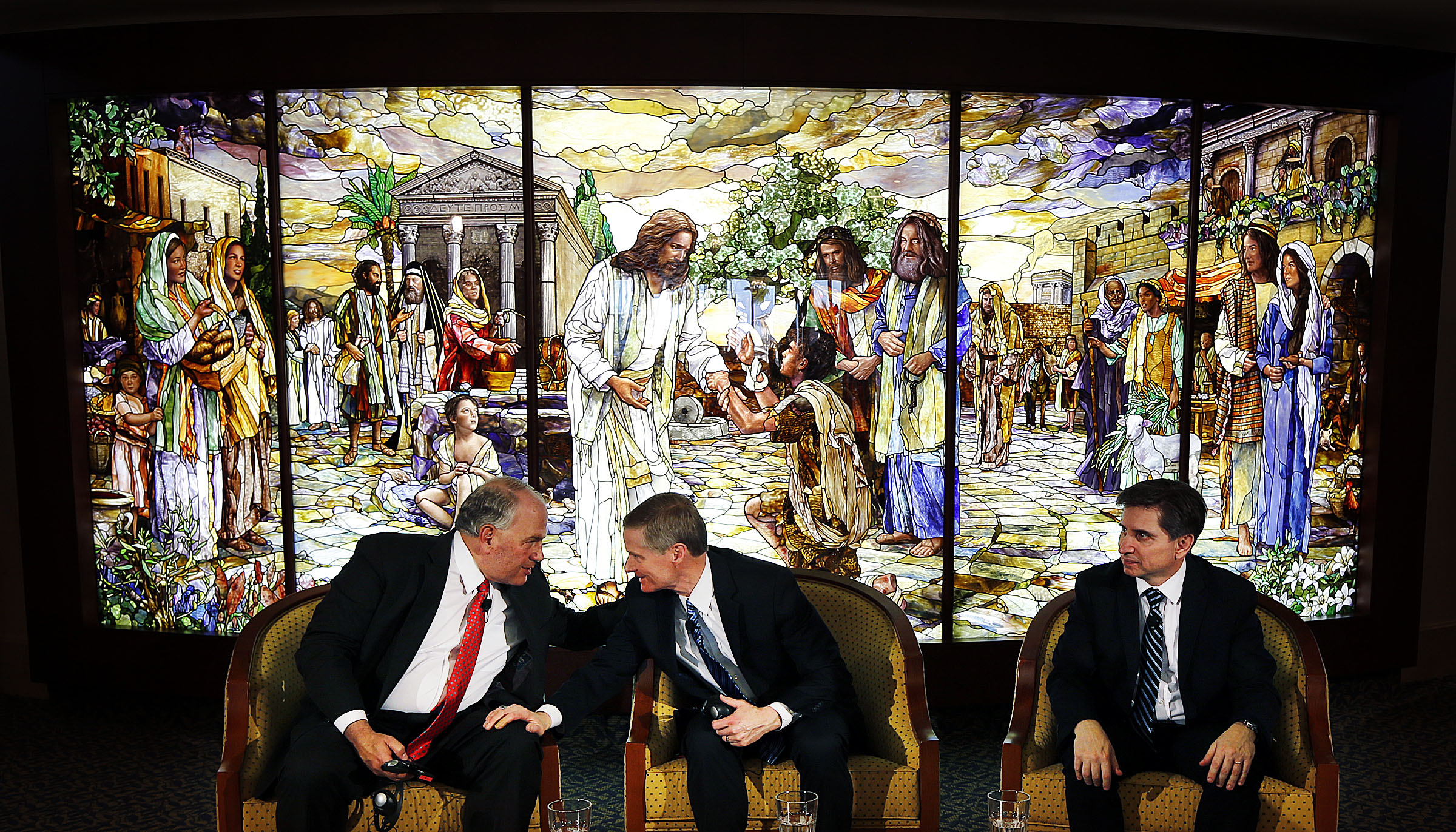 Elder Ronald A. Rasband, left, and Elder David A. Bednar of the Quorum of the Twelve Apostles, along with Elder Massimo De Feo, General Authority Seventy, prepare to begin a press conference in the Rome Temple Visitors' Center of The Church of Jesus Christ of Latter-day Saints on Monday, Jan. 14, 2019.