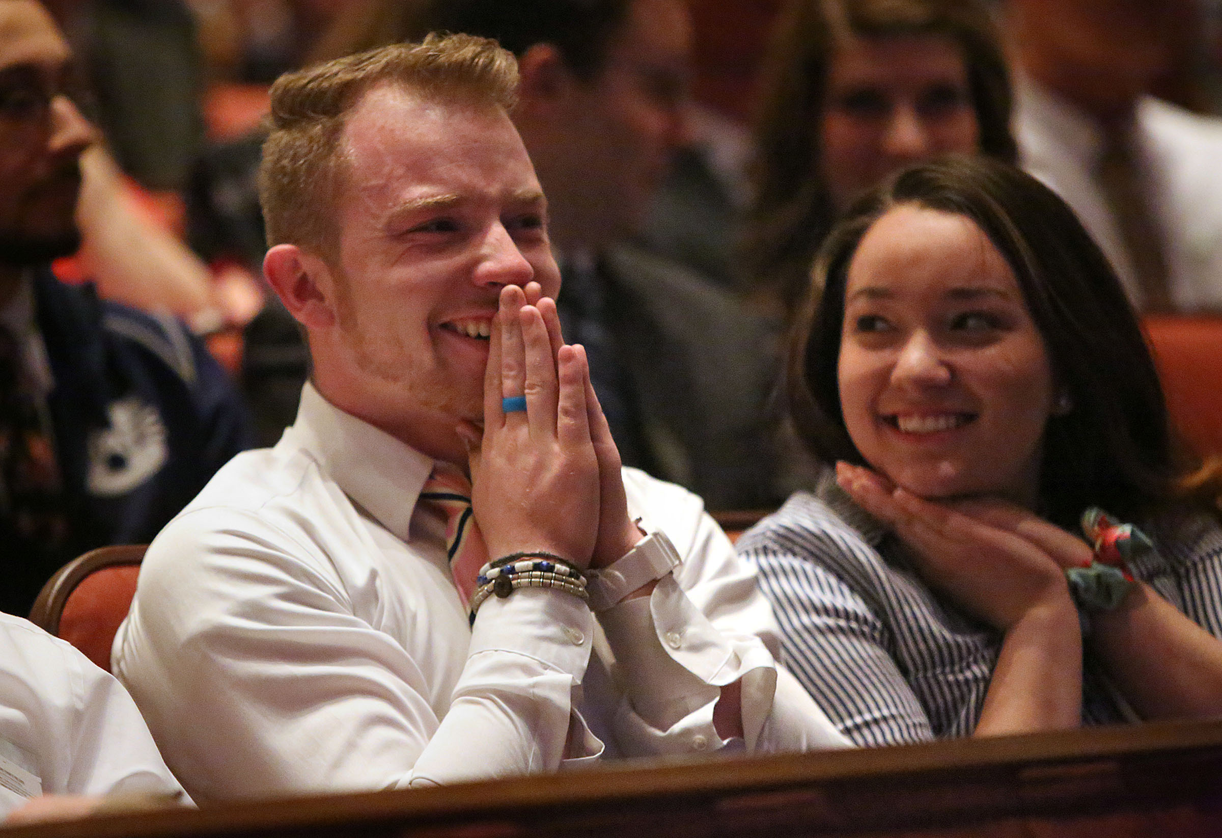 Peter Compton and Carolina Hashimoto react to LDS Church President Russell M. Nelson's announcement that there will be seven new temples around the world, including one in Layton, Utah, during the Sunday afternoon session of the 188th Annual General Conference of The Church of Jesus Christ of Latter-day Saints at the Conference Center in Salt Lake City on Sunday, April 1, 2018.