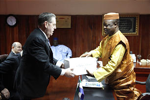 Elder Holland presents a gift on behalf of the Church during his visit with the Vice President of Sierra Leone, Mr. Samuel Sam-Sumana.