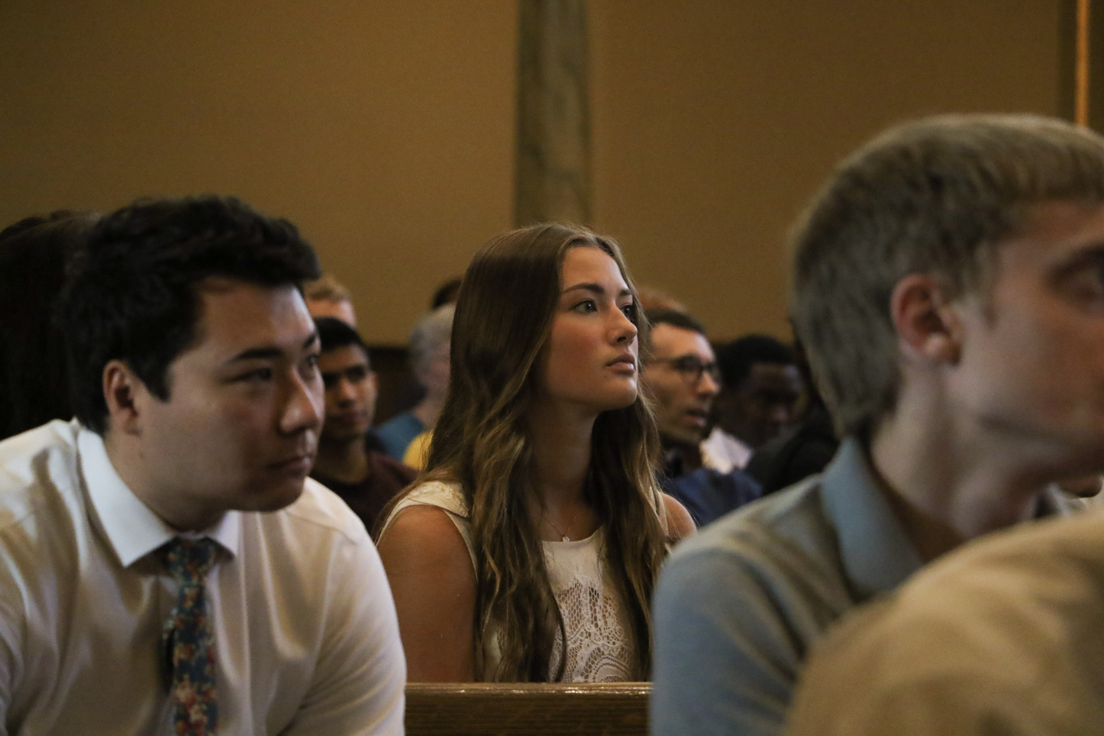 Students, faculty and guests listen to Sister Liz Darger in the Assembly Hall at Temple Square for an LDSBC devotional on June 18, 2019.