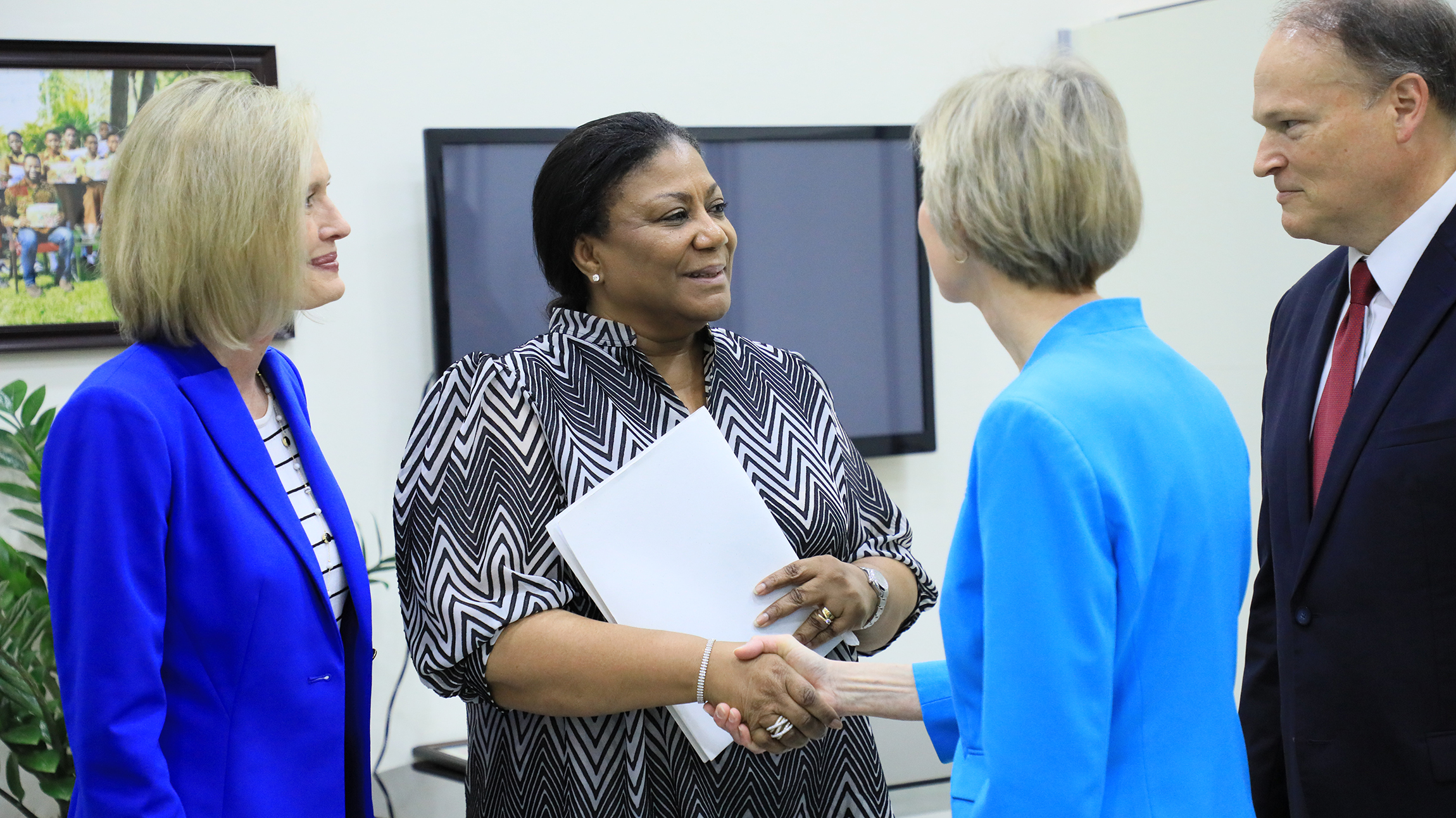 Sister Jean B. Bingham, right, greets Rebecca Naa Okaikor Akufo-Addo, the first lady of the Republic of Ghana, at North Ridge in Accra, Friday, March 1, 2019. Sister Bonnie H. Cordon, left, and Africa West Area President Elder Marcus B. Nash of the Seventy, far right, were also present.