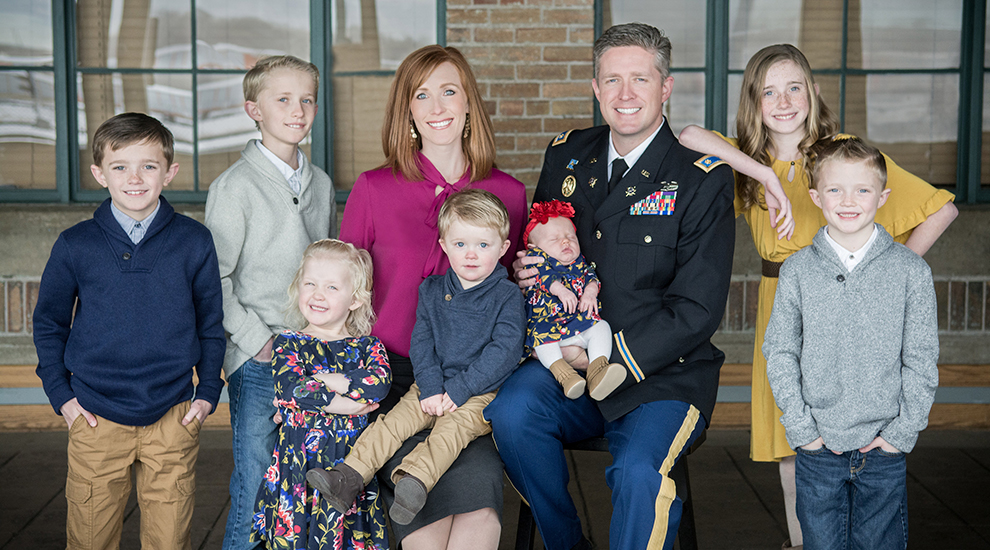 Maj. Brent Taylor and Jennie Taylor along with their seven children.