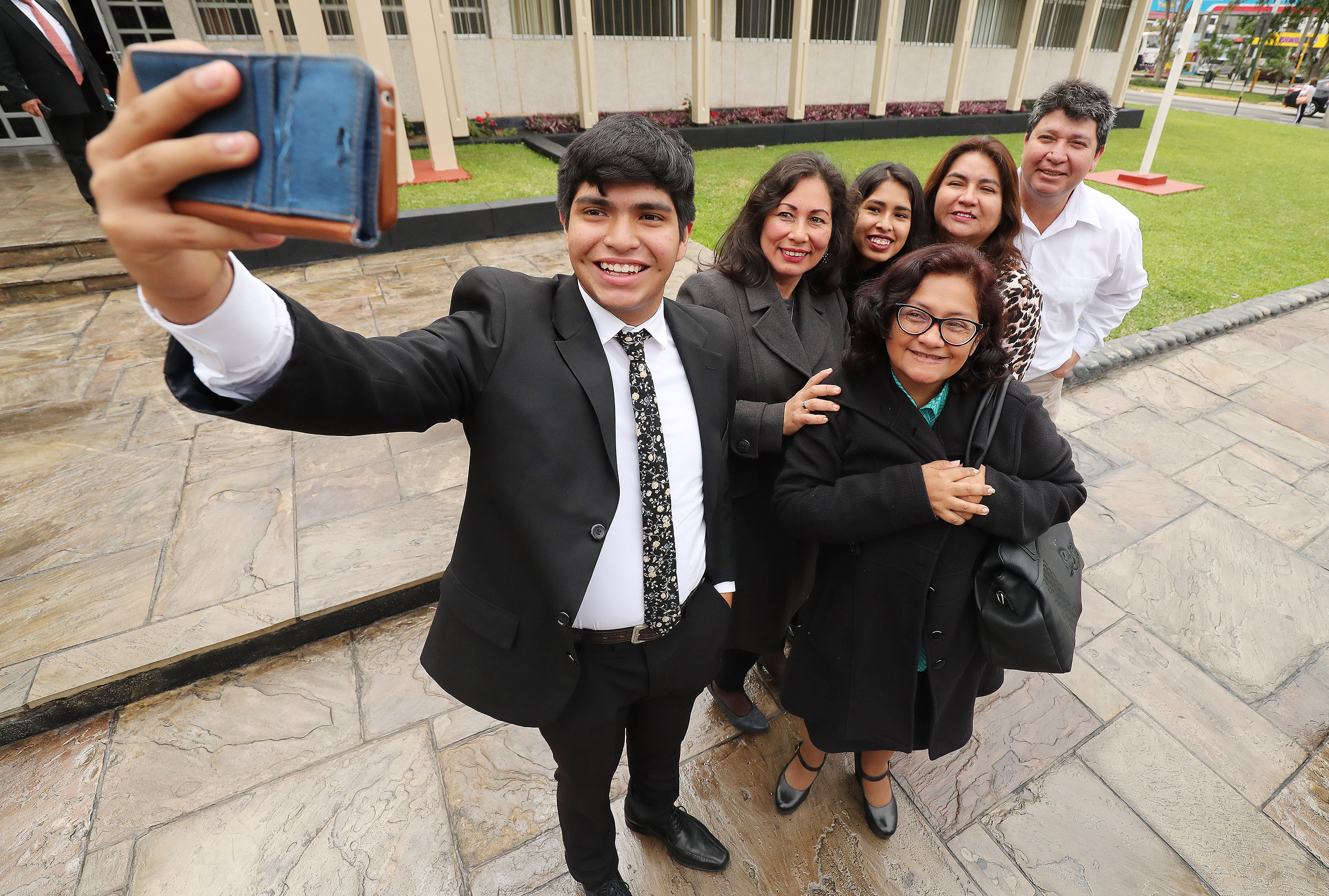 Members of The Church of Jesus Christ of Latter-day Saints shoot a photo after meetings in Lima, Peru, on Oct. 21, 2018.