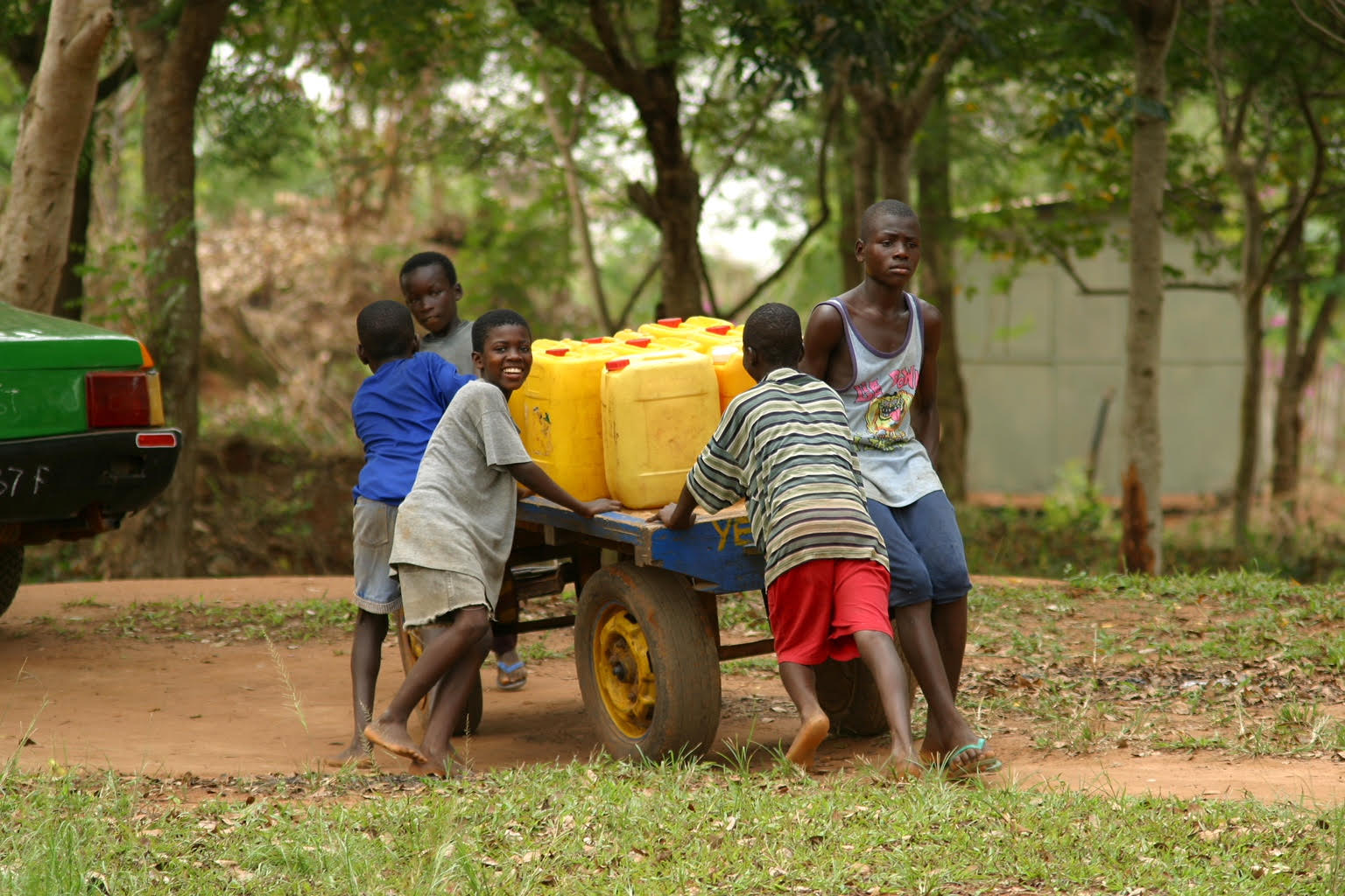 Before Ghana's village of Katapor had access to fresh well water, boys hauled polluted water from a nearby river. In many parts of Africa, women and children walk long distances to bring water to their homes.