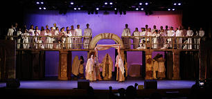 """Mary, bottom left, and Joseph, bottom right, prepare to be married during the Dec. 4 performance of """"El Salvador del Mundo."""" Standing on scaffolding, a choir of cast members dressed as angels contributed to major musical numbers."""
