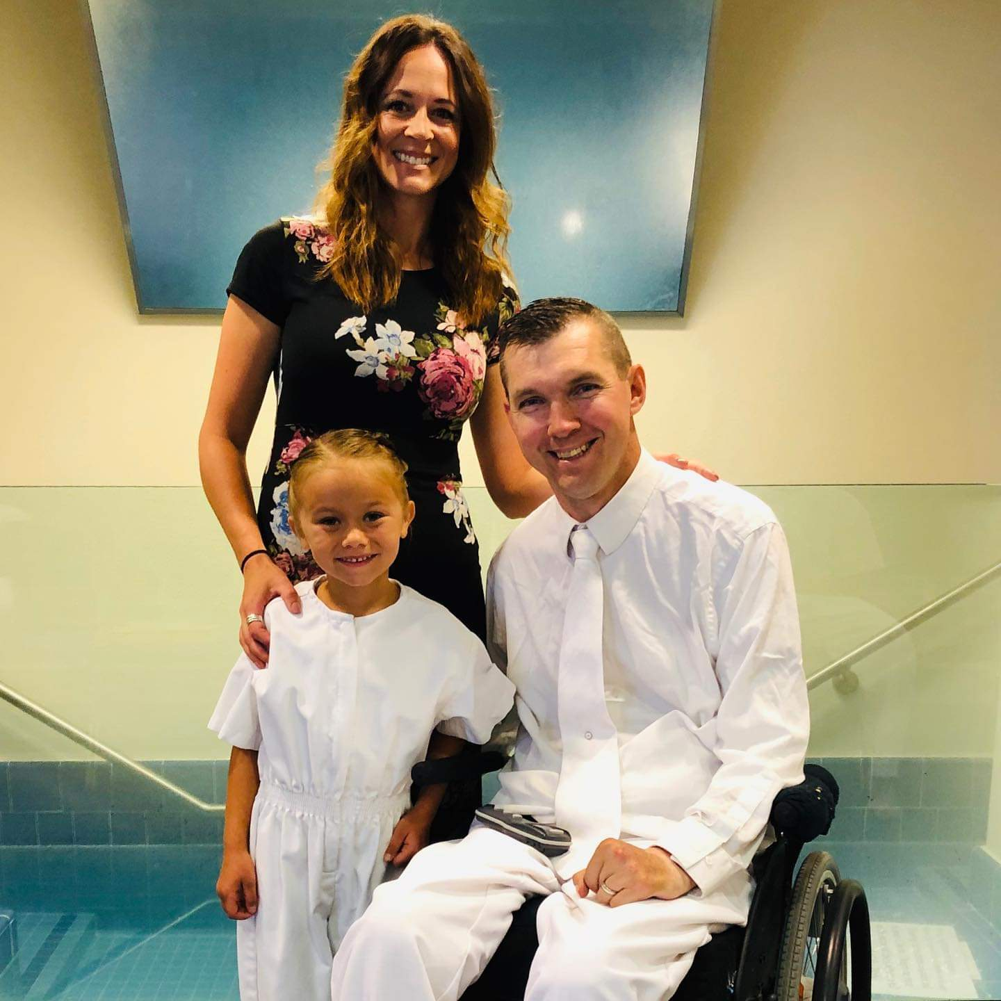 Jarom and Leslie Hlebasko pose with their daughter Miree at her baptism.