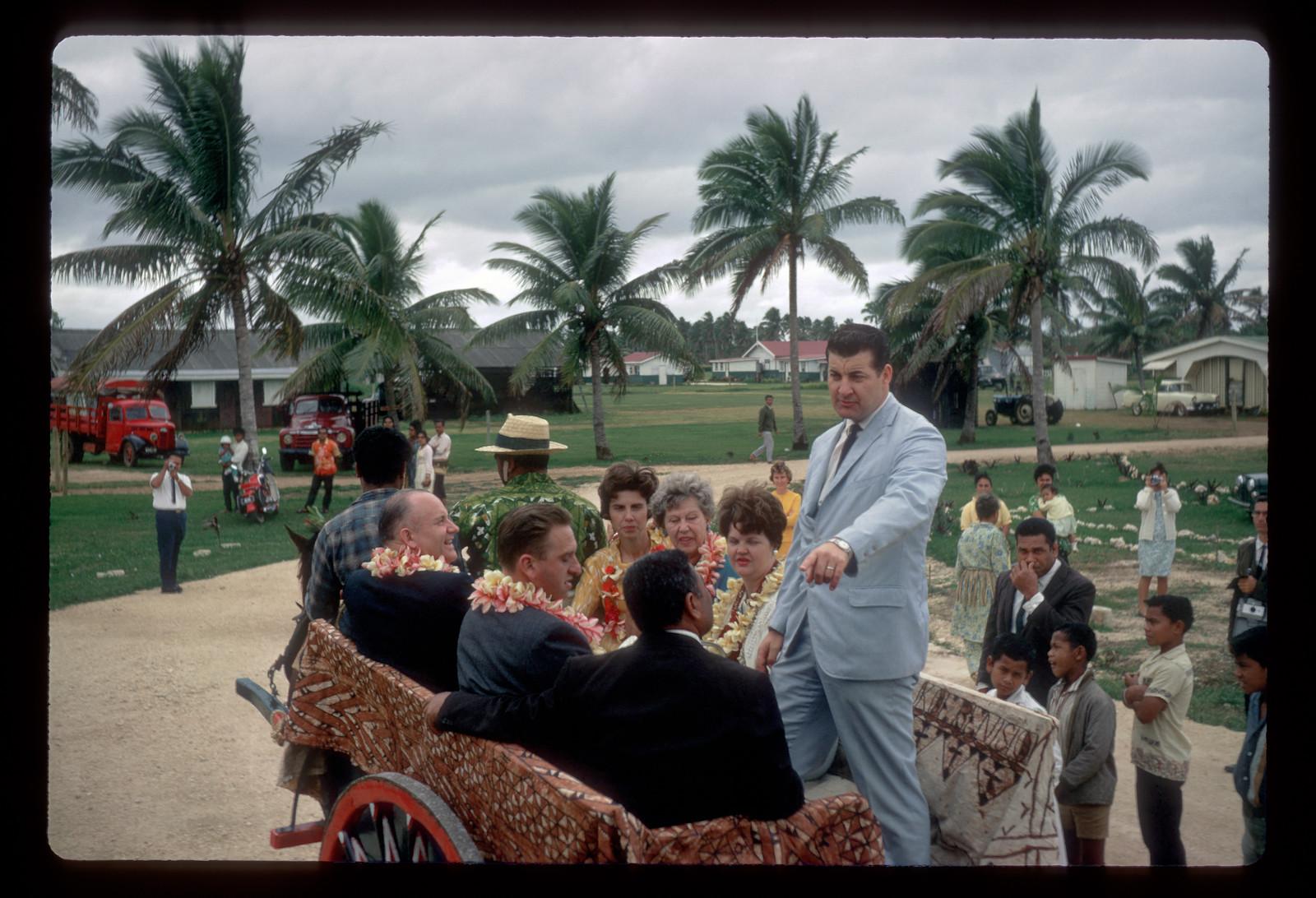 Elder John Groberg, right, of the Tonga Mission, joins Elder Thomas S. Monson, Elder Howard W. Hunter and their wives for a wagon ride in September 1968 in Tonga.