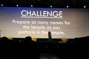 Elder Neil L. Andersen gives a challenge to the youth assembled for the dovtional at Youth Family Discovery Day, part of RootsTech2014