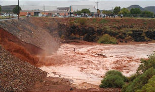 A dike break near Snow Canyon Middle School caused flooding in southern Utah Tuesday, Sept. 11, 2011.