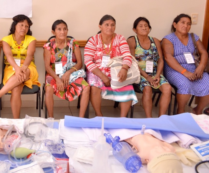 Midwives from Brazil's Guajajara tribe listen to neonatal care instruction at October, 2018, training seminar. The event was co-sponsored by the Church.
