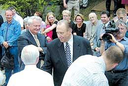 President Thomas S. Monson, followed by Elder Merrill J. Bateman, greets Maeser family and friends gathered for dedication.