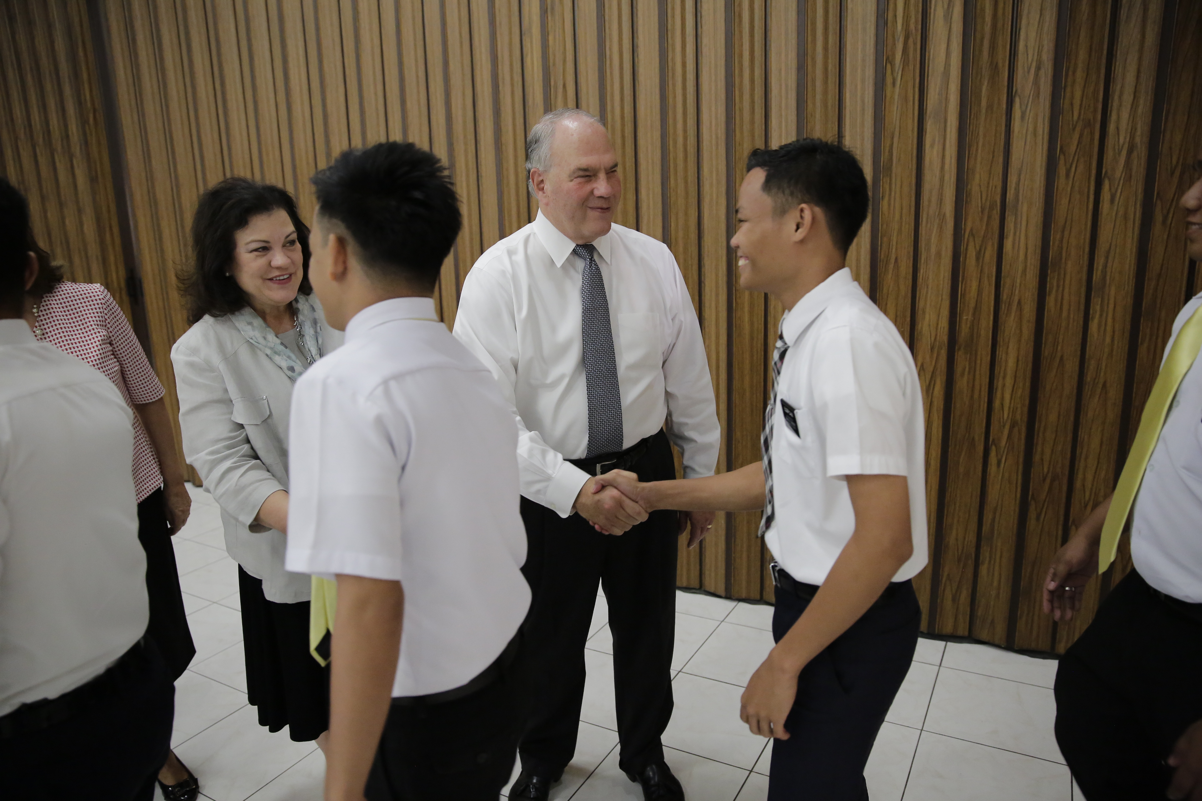 Elder Ronald A. Rasband visits with missionaries during his Feb. 13-26, 2018, trip to the Church's Philippines Area.