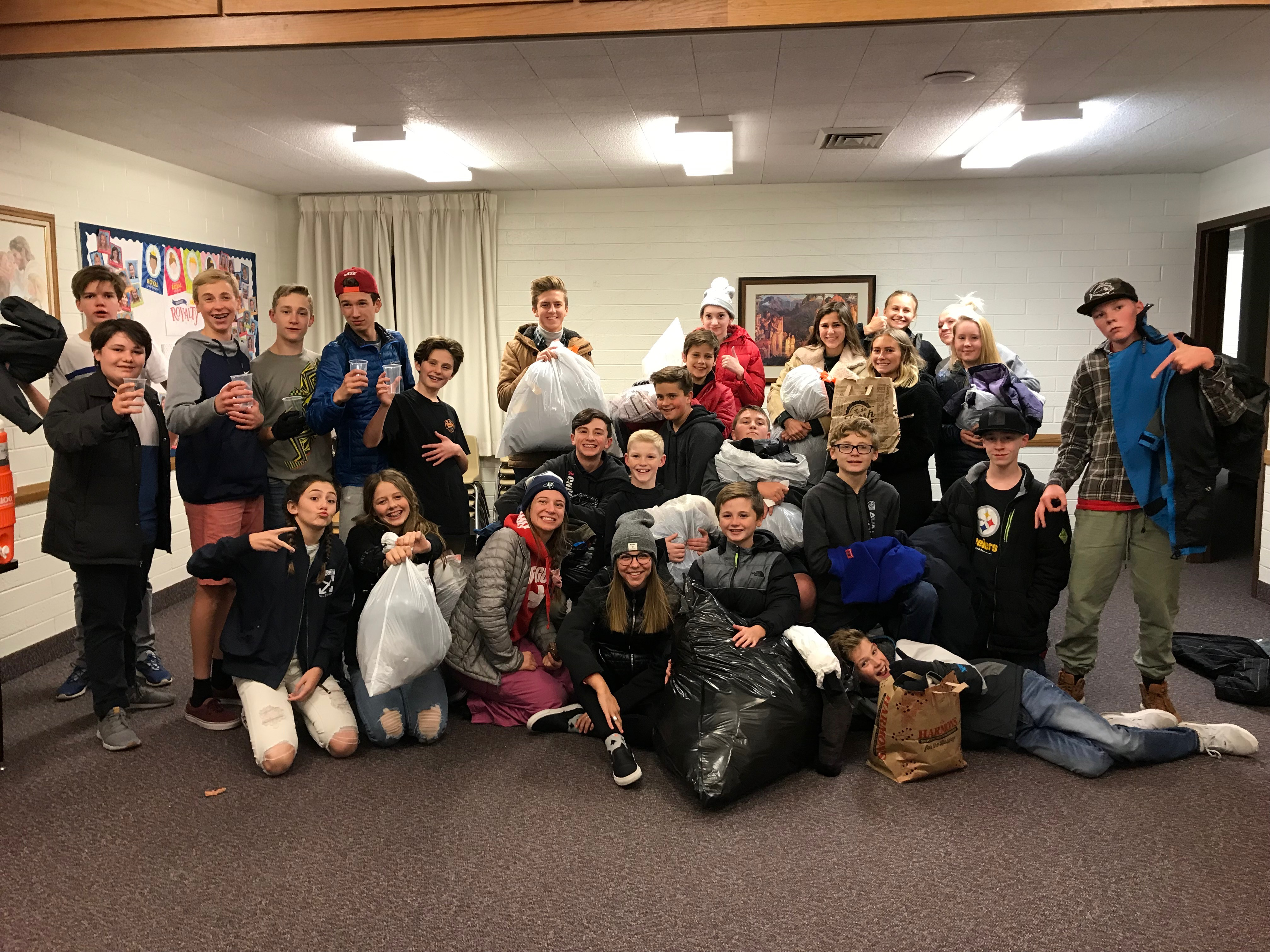 Youth groups from the Draper 5th ward assembled to help collect coat donations for the Ferran family's November project.