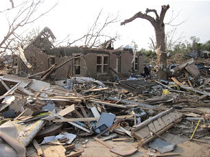 Photo of Wade and Colleen Robbins' home following the tornado. Sister Robbins and her 1-year-old granddaughter, McKenna, were in the home when the tornado hit. Both survived, having sought refuge in a bedroom closet moments before the storm hit.