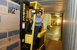 David Vazquez loads packages of food, blankets, and medical supplies onto a truck at the Central Bishops Storehouse. The LDS church is sending humanitarian assistance to Afgan refugees. Monday, November 5, 2001. Photo/Johanna Workman
