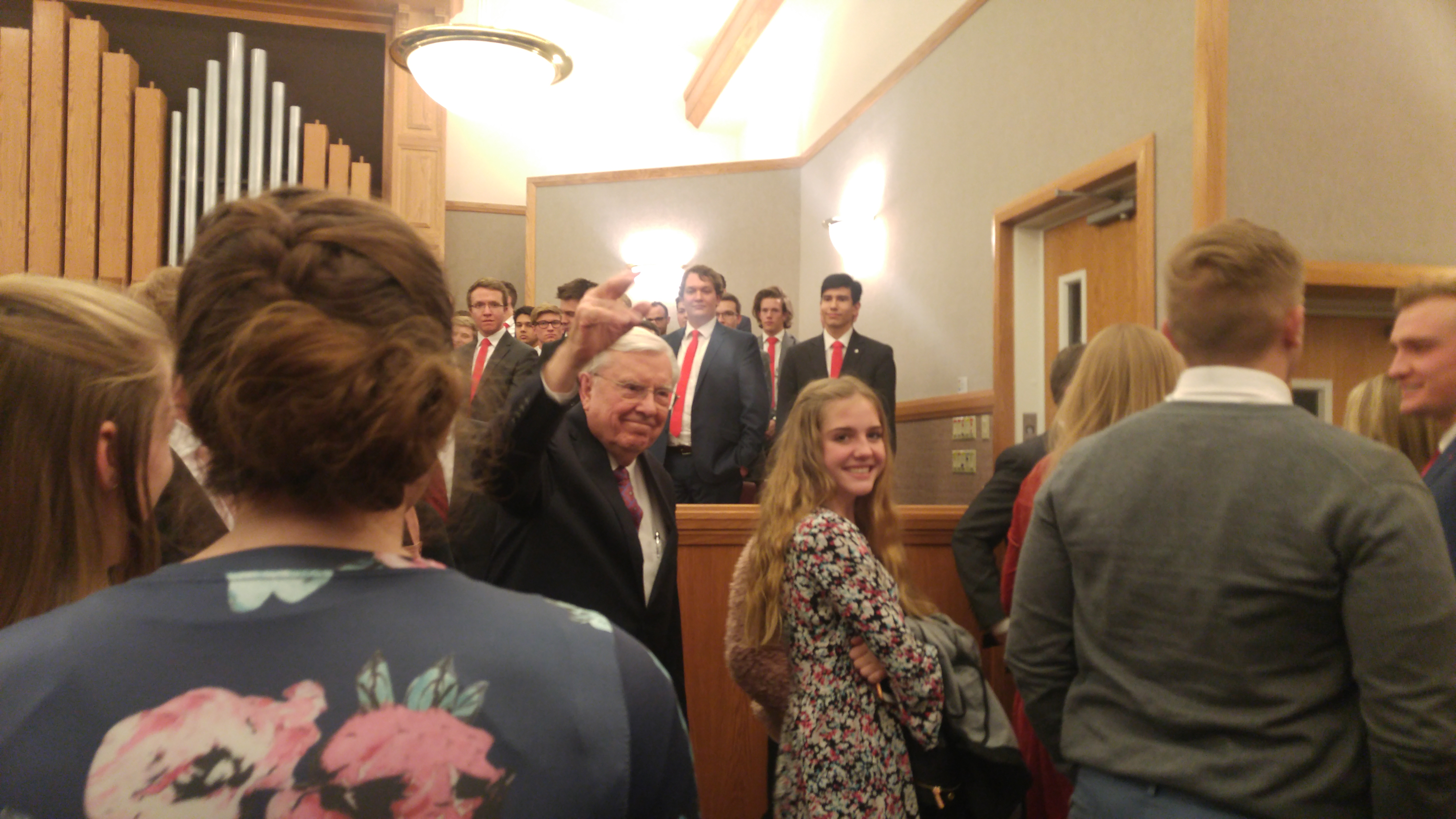 President M. Russell Ballard waves to students as he leaves the Salt Lake Institute following a devotional on Sunday, Feb. 10, 2019.