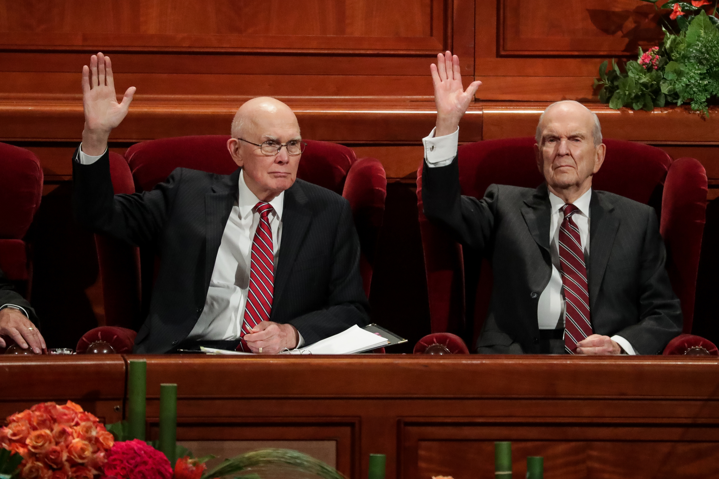 President Dallin H. Oaks, first counselor in the First Presidency, left, and President Russell M. Nelson, right, raise their hands to sustain church leaders during the Saturday afternoon session of the 188th Semiannual General Conference of The Church of Jesus Christ of Latter-day Saints in the Conference Center in Salt Lake City on Saturday, Oct. 6, 2018.