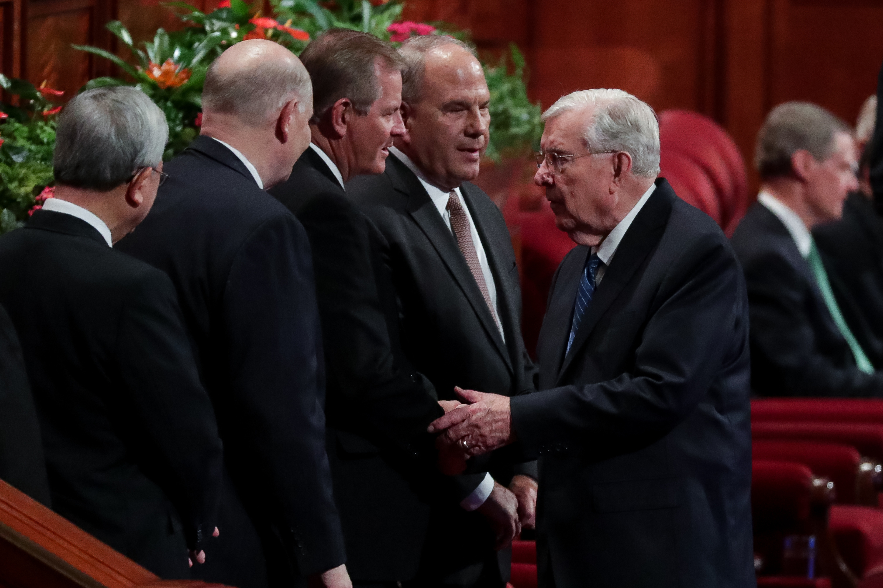 President M. Russell Ballard, acting president of the Quorum of the Twelve Apostles, greets Elder Gary E. Stevenson and other members of the Quorum of the Twelve Apostles, before the Saturday morning session of the 188th Semiannual General Conference of The Church of Jesus Christ of Latter-day Saints in the Conference Center in Salt Lake City on Saturday, Oct. 6, 2018.
