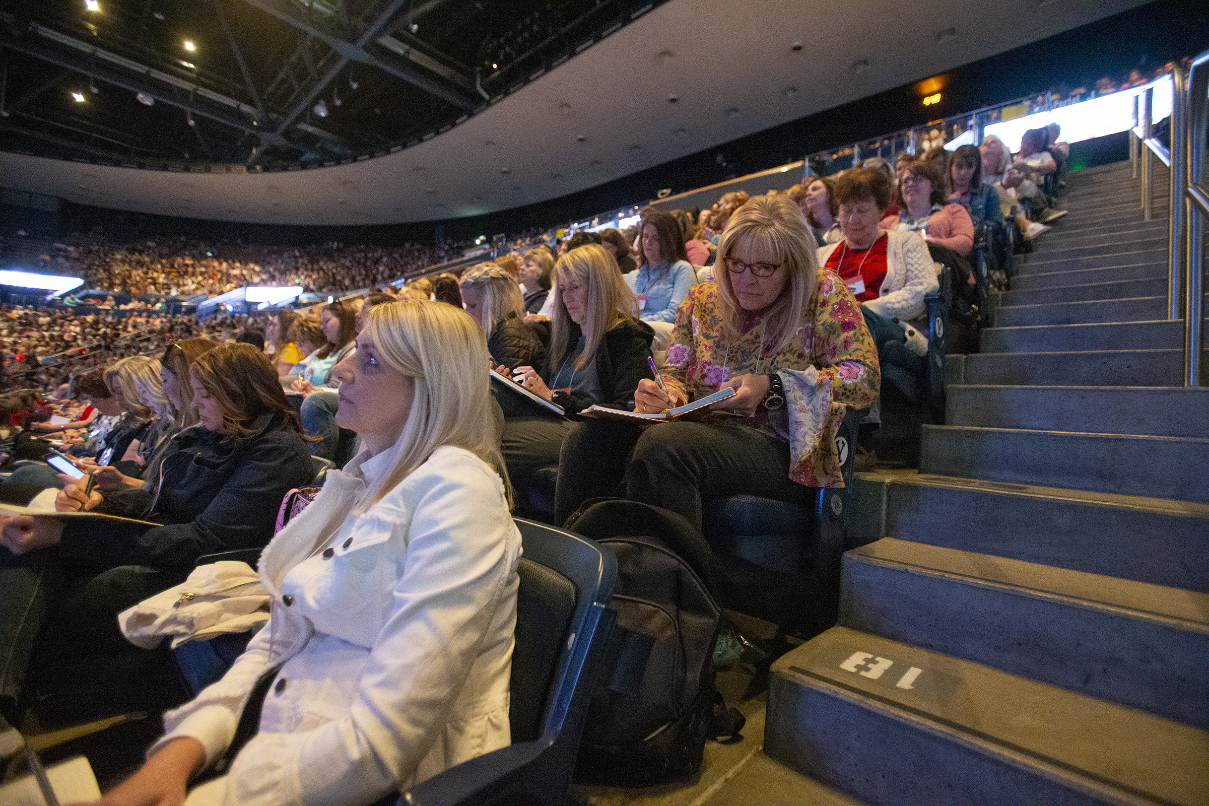 "Women take notes as they attend a ""Sister to Sister"" event at women's conference at BYU's Marriott Center in Provo on Friday, May 3, 2019."