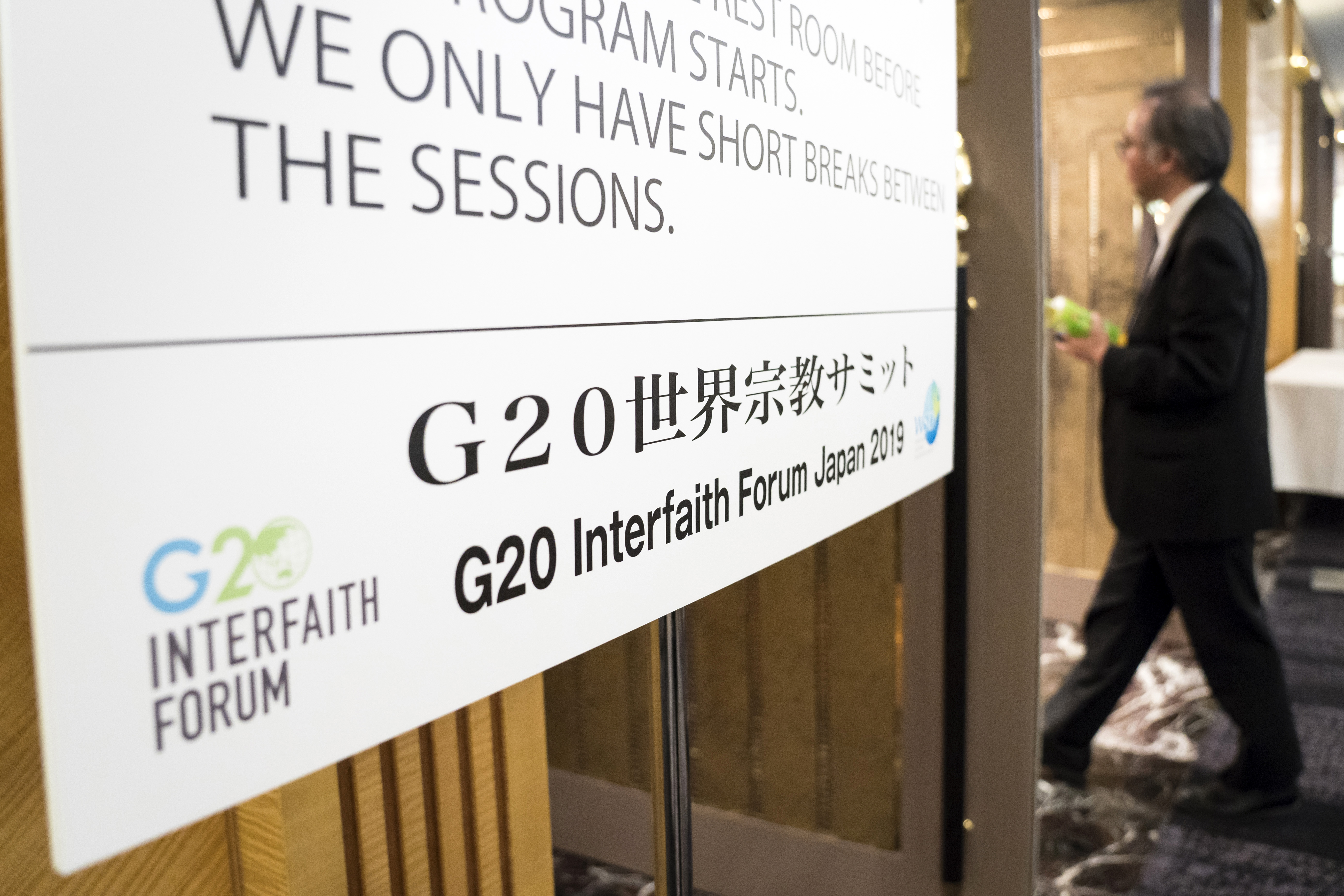 An attendee enter a conference room during the G20 Interfaith Forum in Chiba, Japan, on Saturday, June 8, 2019.