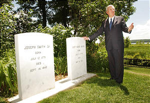 Church news--Elder Ballard talks about gravesites to media after the Joseph and Hyrum Smith commemoration service June 27th, 2002. Allred/photo (Submission date: 06/27/2002)