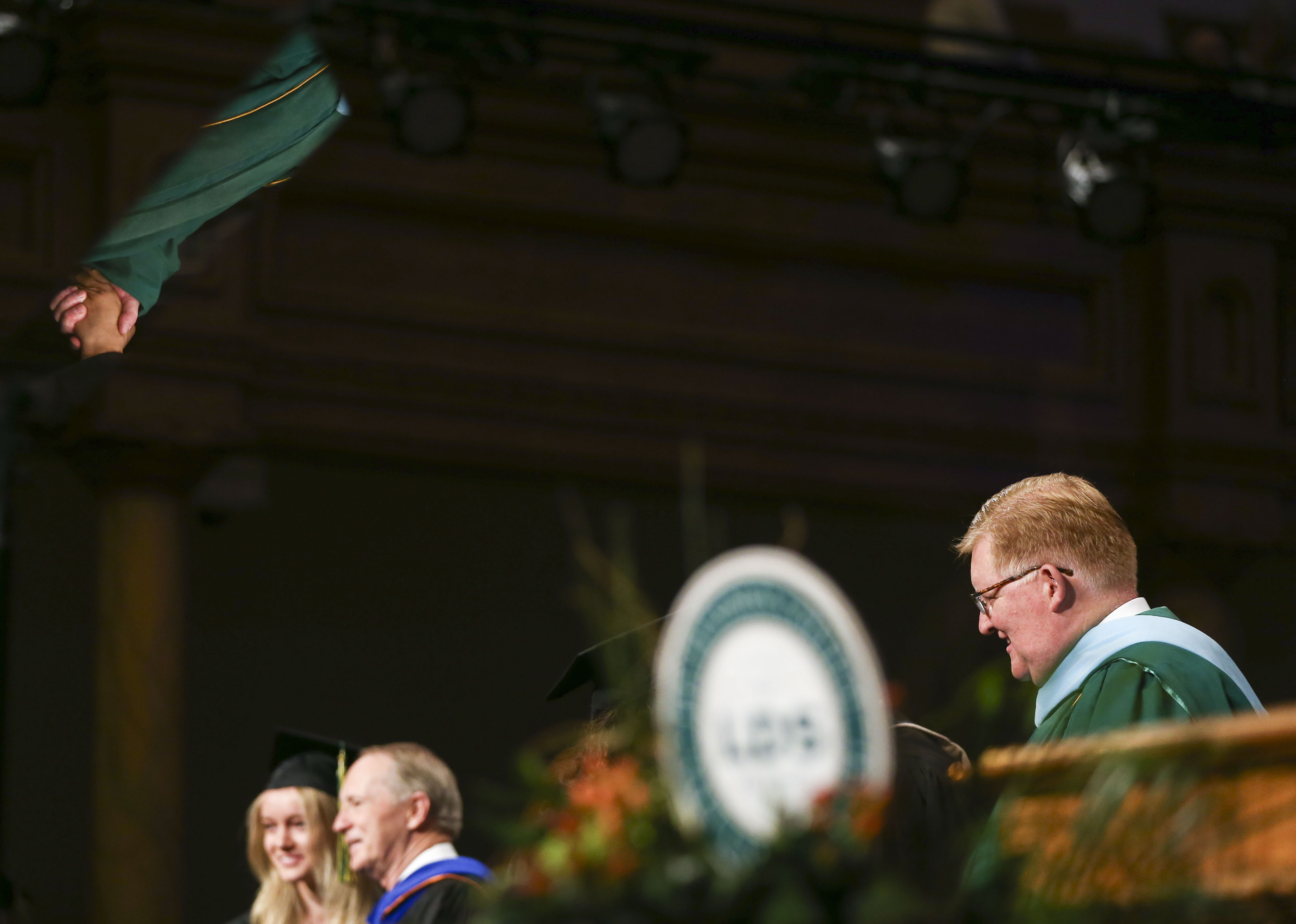 Brother R. Kelly Haws shakes hands with graduates during the commencement ceremony for the LDS Business College at the the Tabernacle on Temple Square in Salt Lake City on Friday, April 12, 2019.